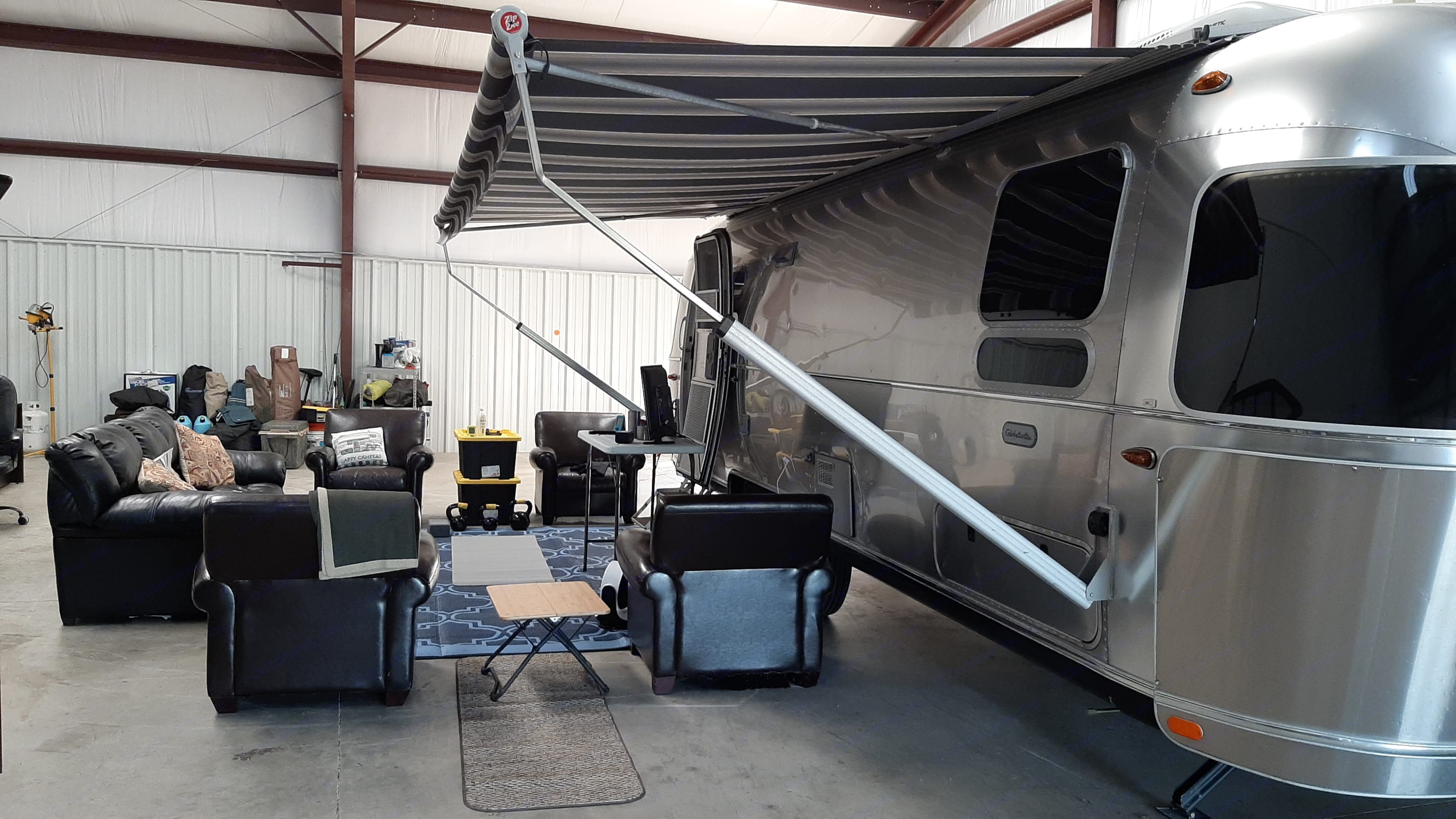 Displays deployed automatic awning stored in man cave. Airstream Globetrotter 2018