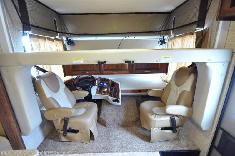 Bunk bed over front seats drops down. Coachmen Mirada 2016