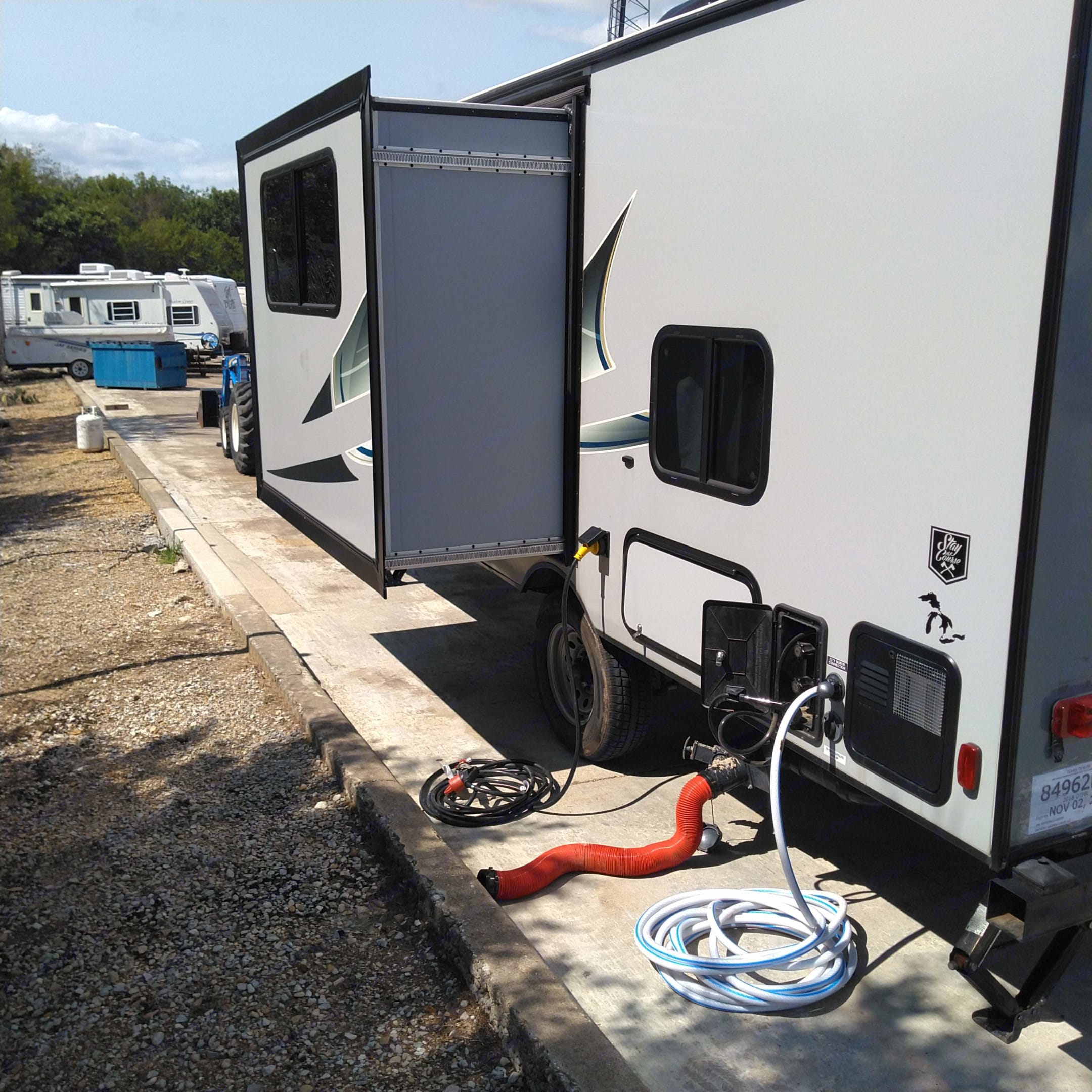 Outside shower & campground hookup equipment included. Coachmen Apex 2018