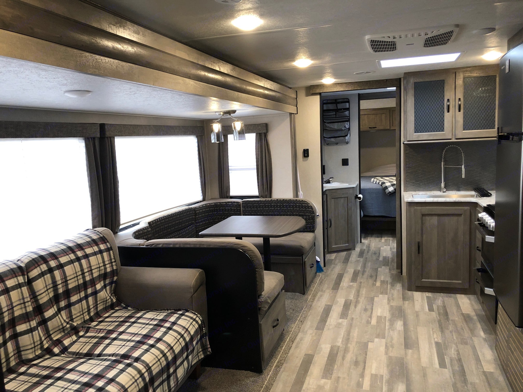 Roomy Interior, fold out couch and table sleeps 2. All fresh bedding provided.. Forest River Vibe 2020