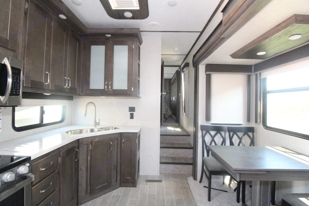 Kitchen with dining table/ seating for 4. Keystone Montana High Country 2020