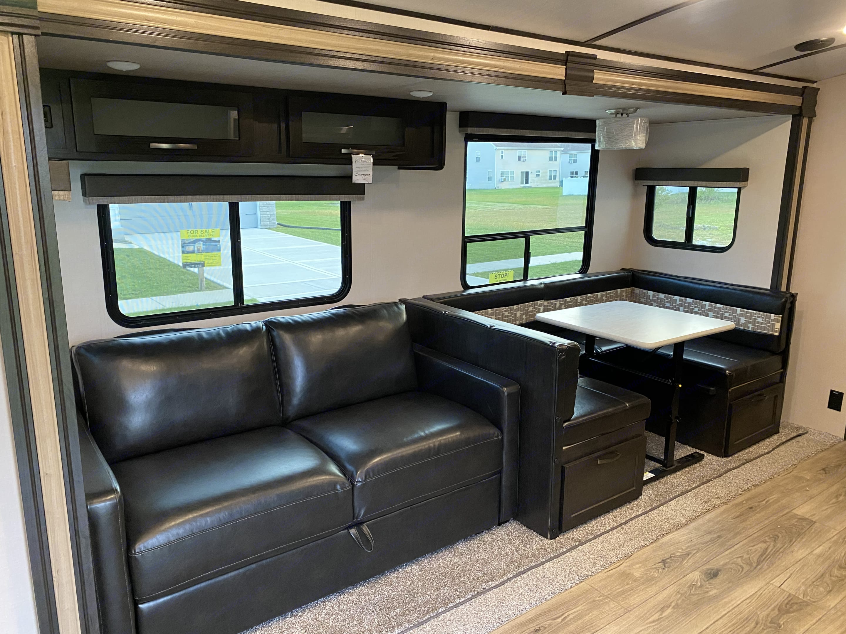 Loveseat that converts to a bed and dining booth that also converts to a bed.. Forest River Surveyor 2019