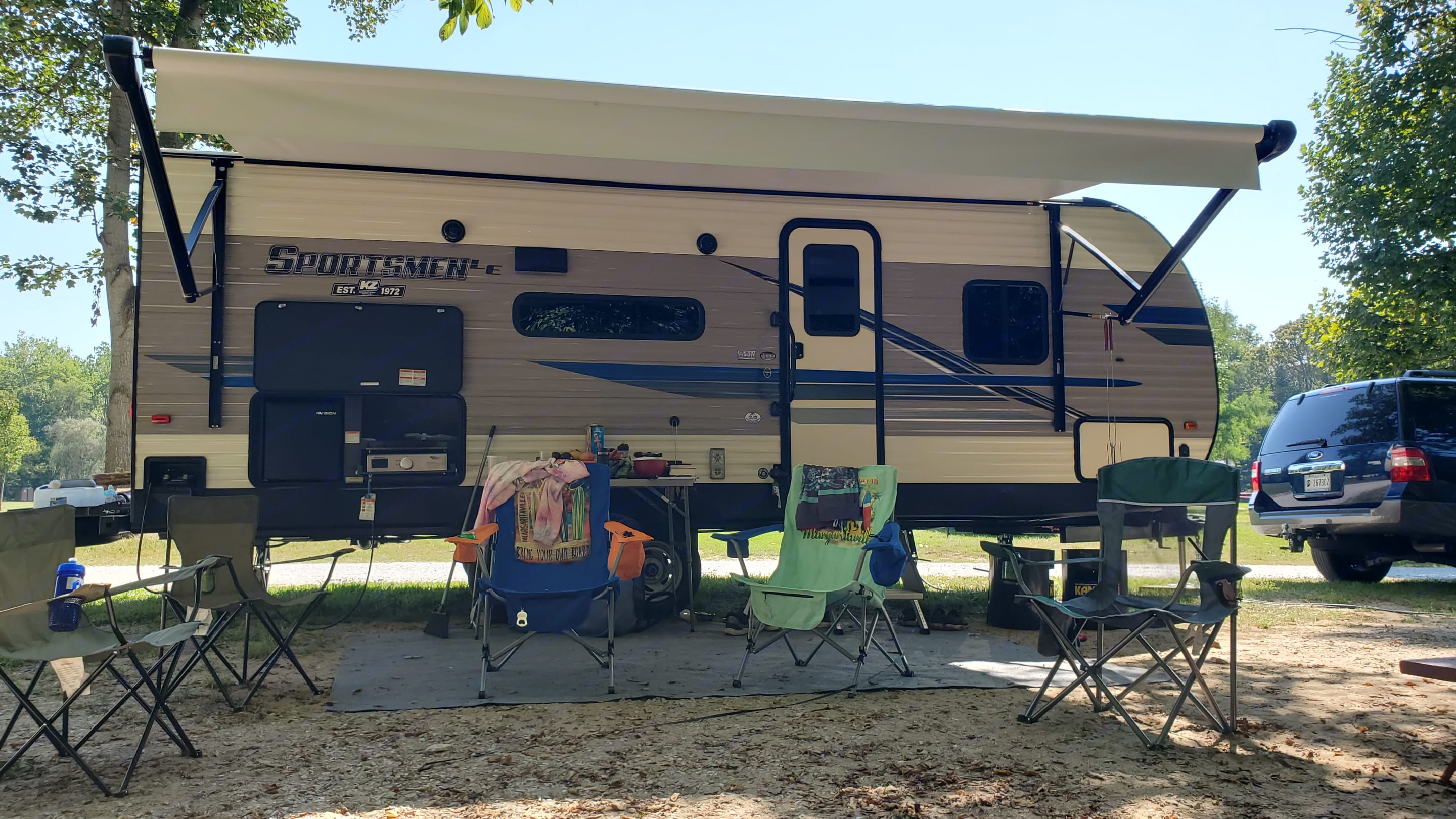 Front View with Awning Set-up. K-Z Manufacturing Sportsmen 2021