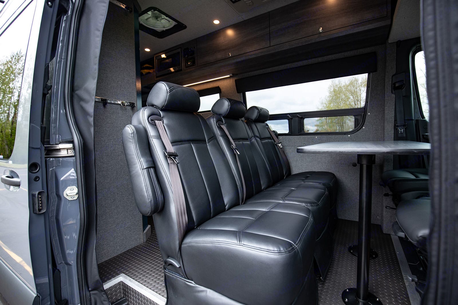 Premium leather chairs make long road trips more comfortable.  Is your party smaller?  Extra seats are removable for additional walking space.. Mercedes-Benz Sprinter 2019