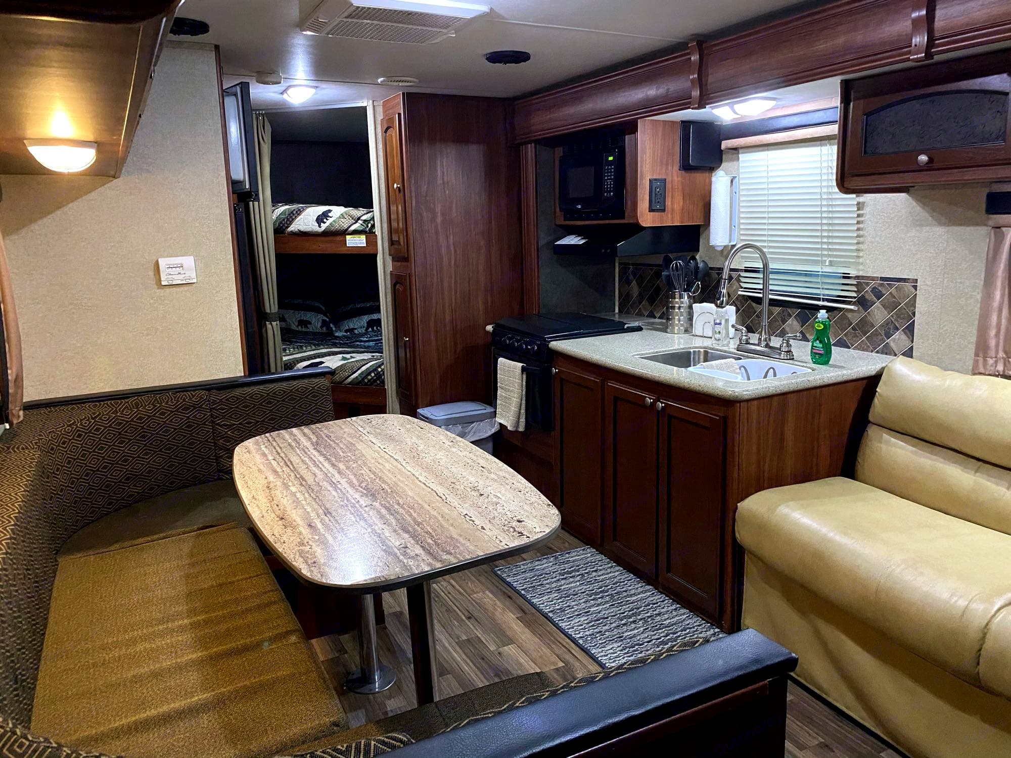 U Shaped Dinette with storage under the Benches. Heartland North Trail 2014
