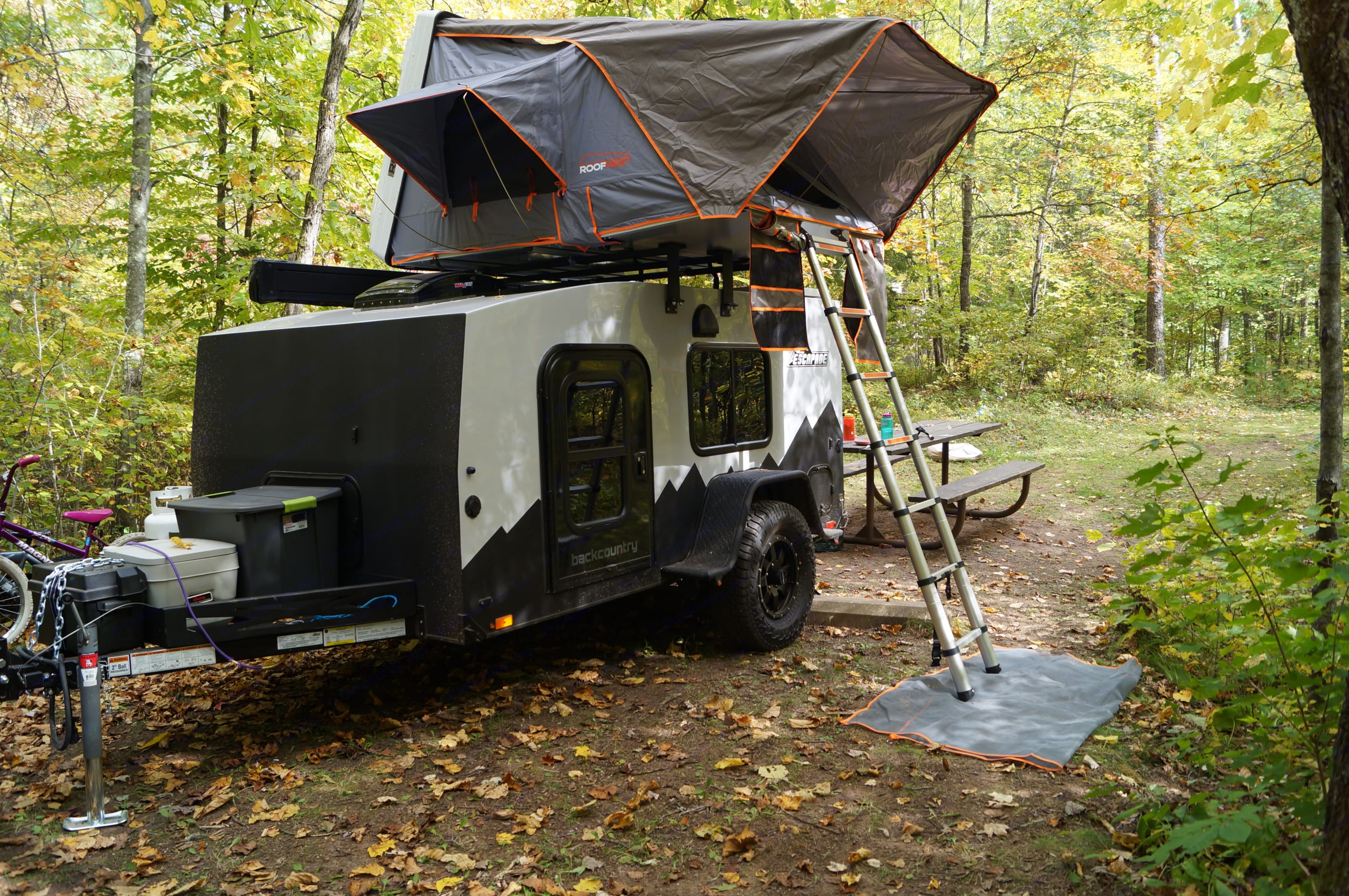 Camper pictured with the Condor open.  See the ample tongue storage and heavy duty fenders.. Custom Camper 2020