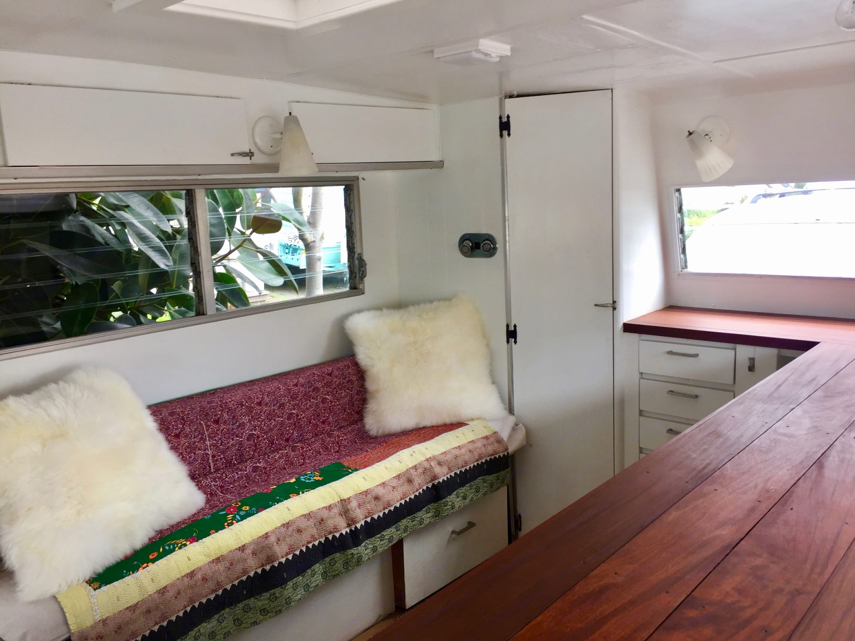 Bench that pulls out to bed.  Closet.  Storage above and below bench.. Aristocrat Lo-Liner 1968