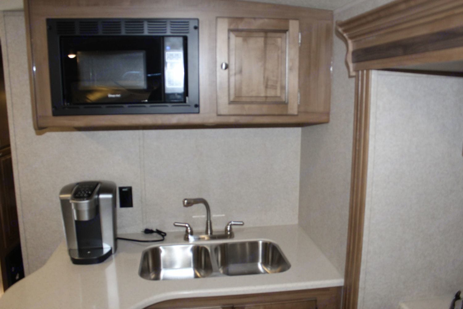 Sink & Microwave. Two basin sink makes it easy to do dishes.  The microwave only works when trailer is on generator power or plugged into the grid.. Forest River Rockwood Roo FL 2018