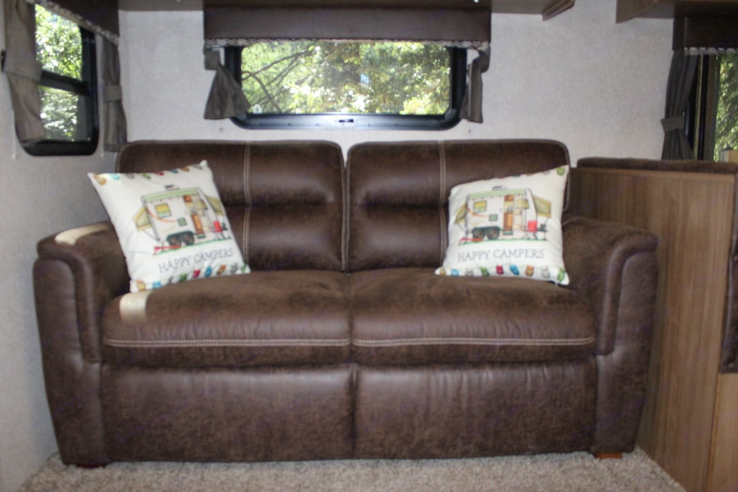 Sofa transforms into a sofa bed which is good for 1 adult, or 2 kids.  Simple to open and close.. Forest River Rockwood Roo FL 2018