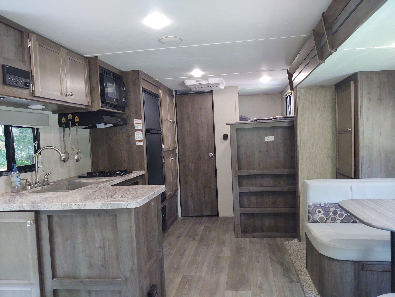 Bathroom and bunk beds in back, lots of storage.. Dutchmen Coleman 2019