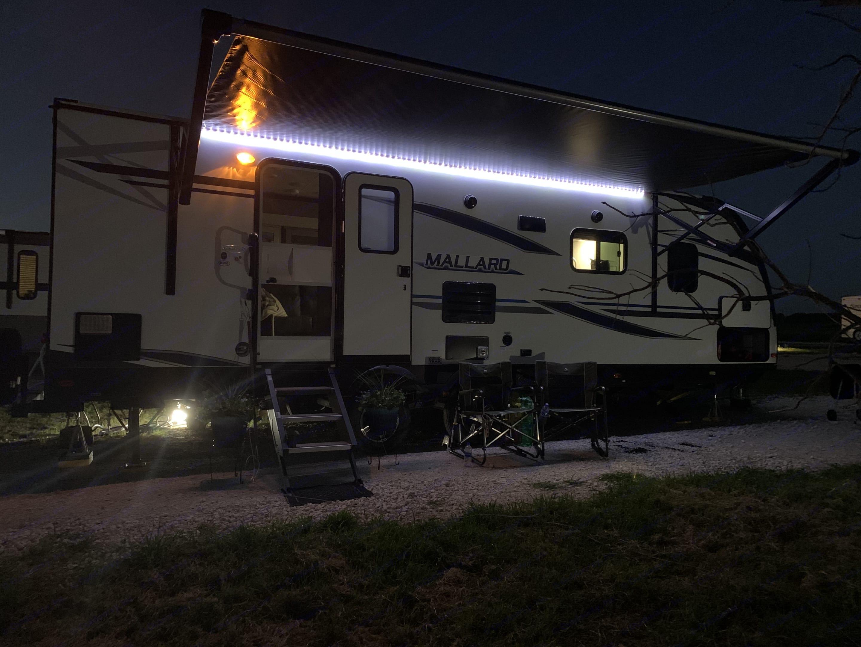 LEDs and awning at night.... Heartland Mallard 2020