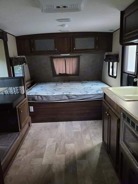 Queen bed that doubles as a seating area. Huge storage underneath the bed.. Coachmen Apex 2019