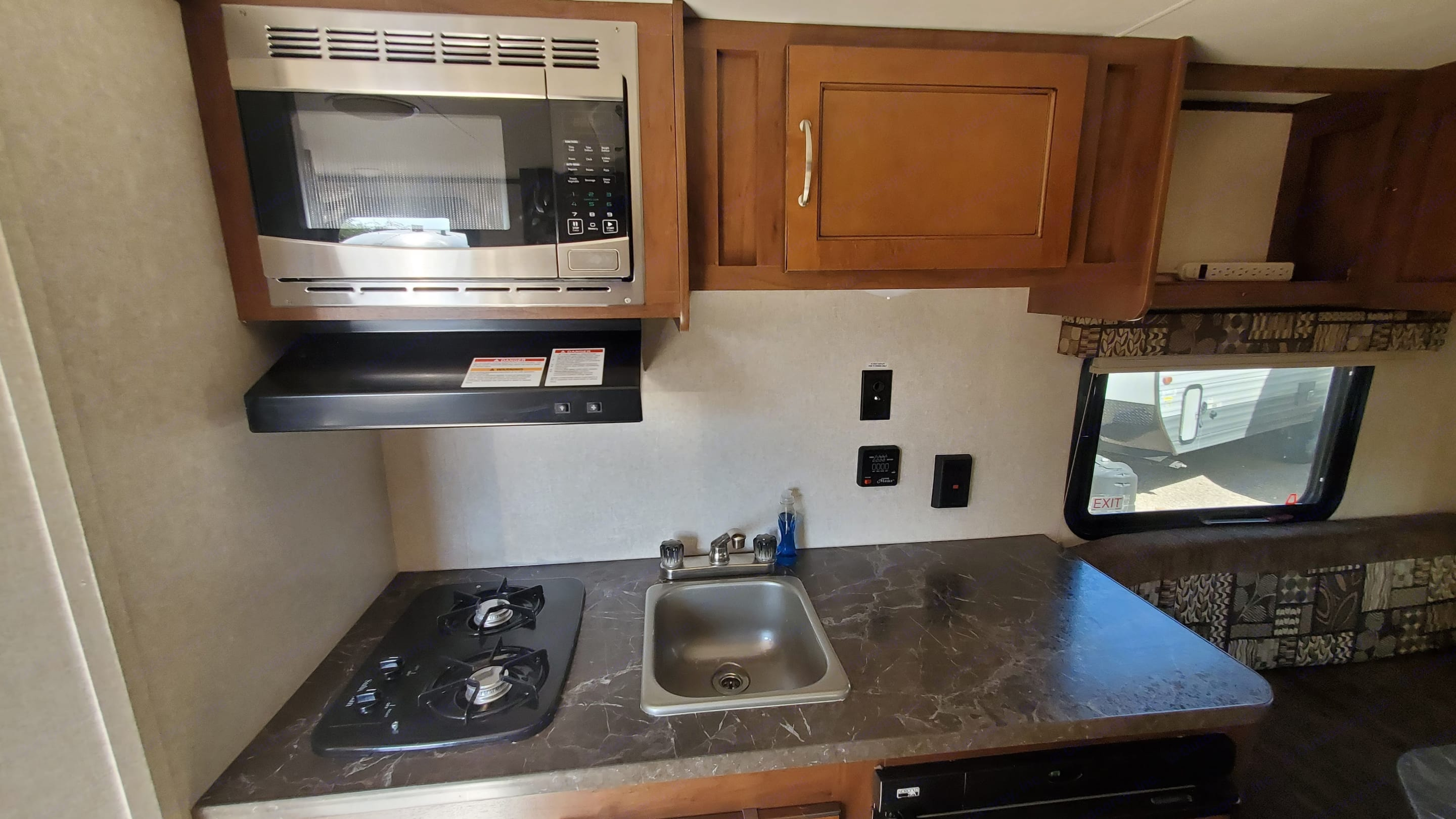 Kitchen with ample countertop space. The kitchen also has a microwave/fume extractor, 2 burner stove, and SS sink.. Jayco Jay Flight 2017