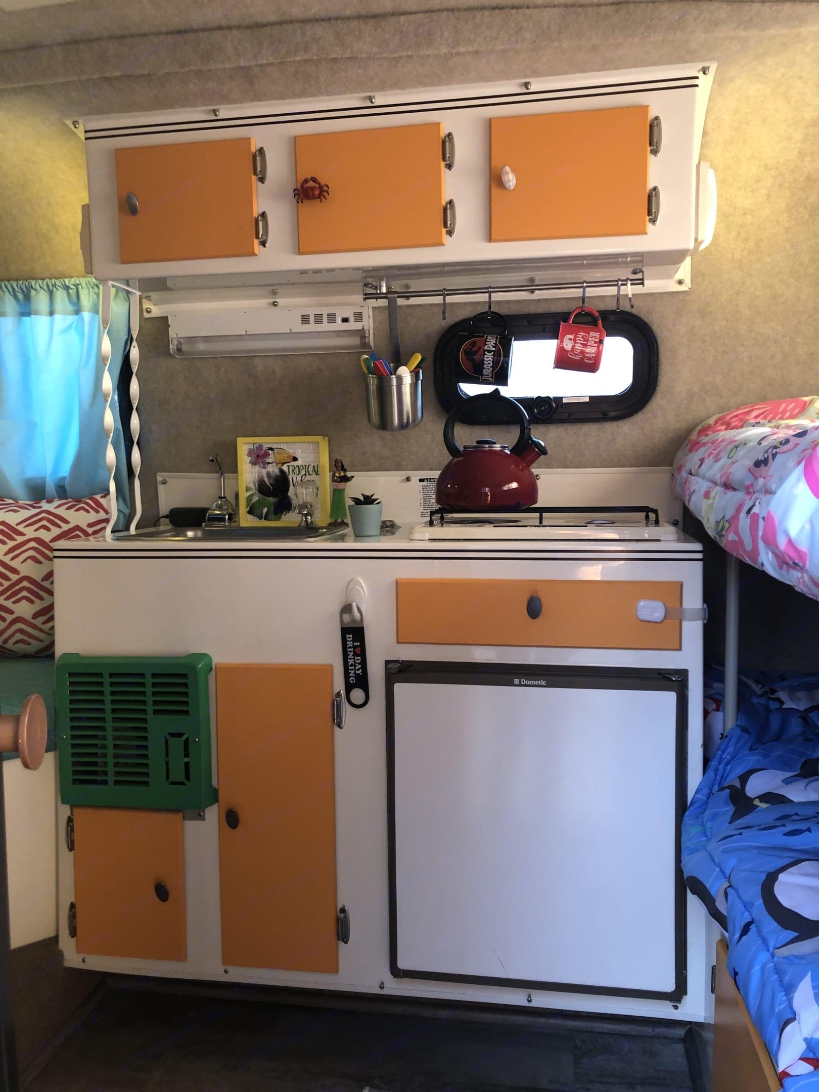 3-way fridge, propane stove & sink.. Scamp 13' 2005