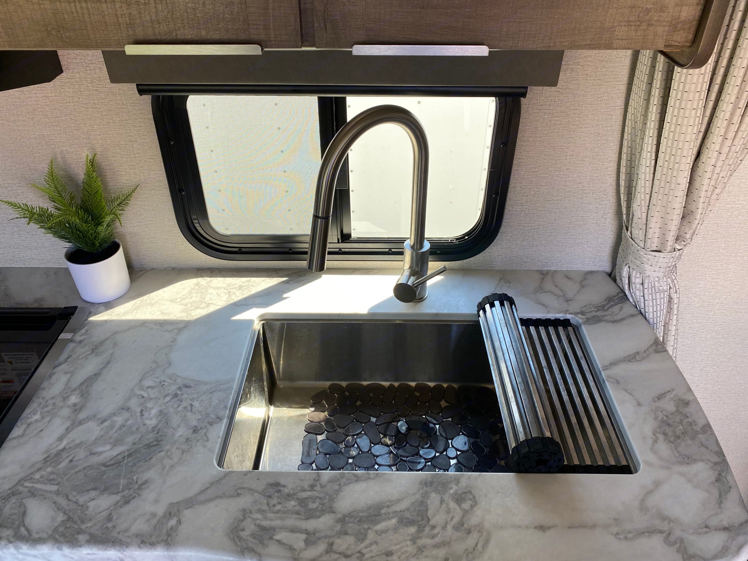Deep seated stainless steel kitchen sink with roll up drying mat.. Grand Design Other 2021