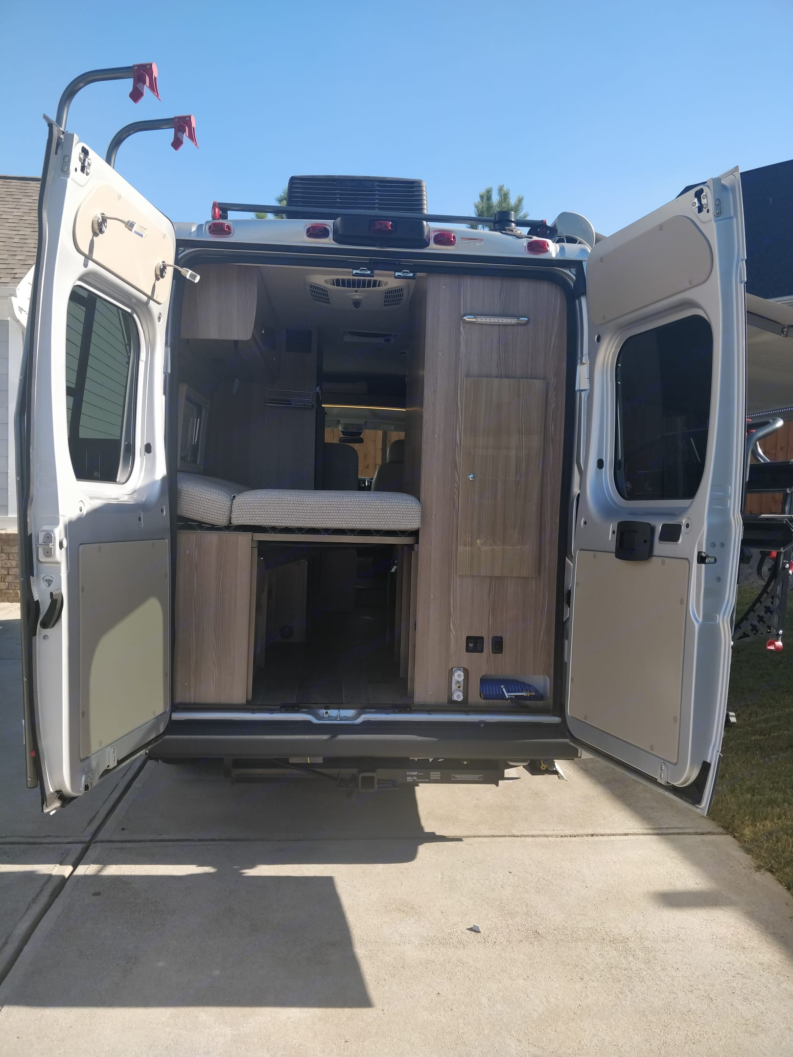Murphy bed sleeps two and is cozy. Storage under bed is handy.  Water house for outside showering or cleaning dirty bikes and feet.. Winnebago Travato 2019