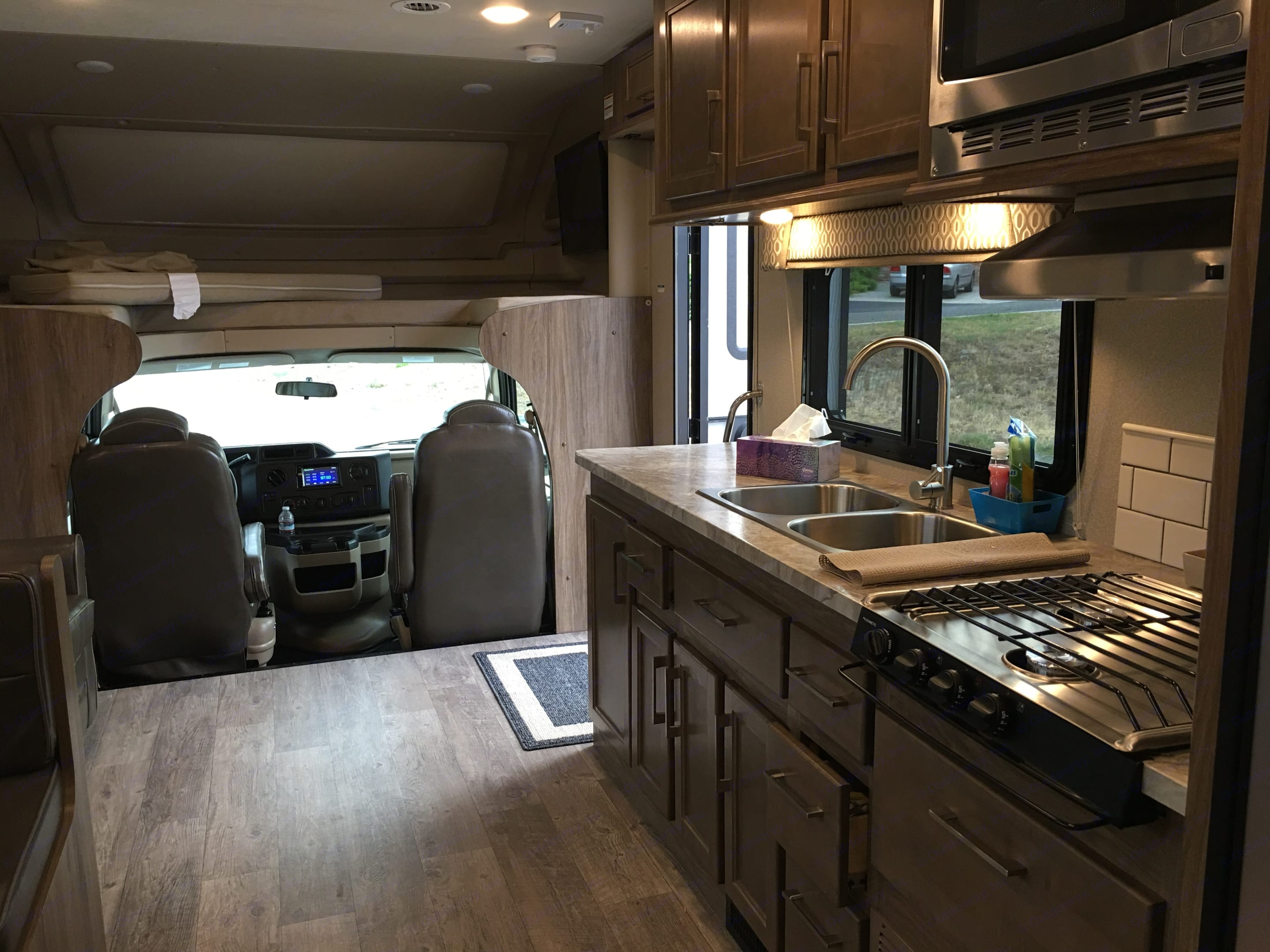 3-burner stove, microwave, convection oven. Everything but the kitchen sink....oh wait, there it is.. Jayco Entegra 2018