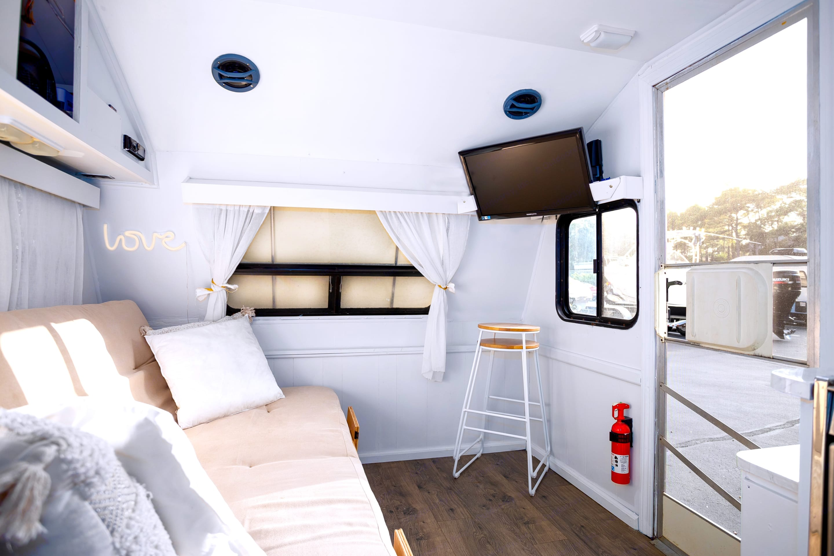 Interior, couch folds out to Full futon bed. Fleetwood Prowler 1992