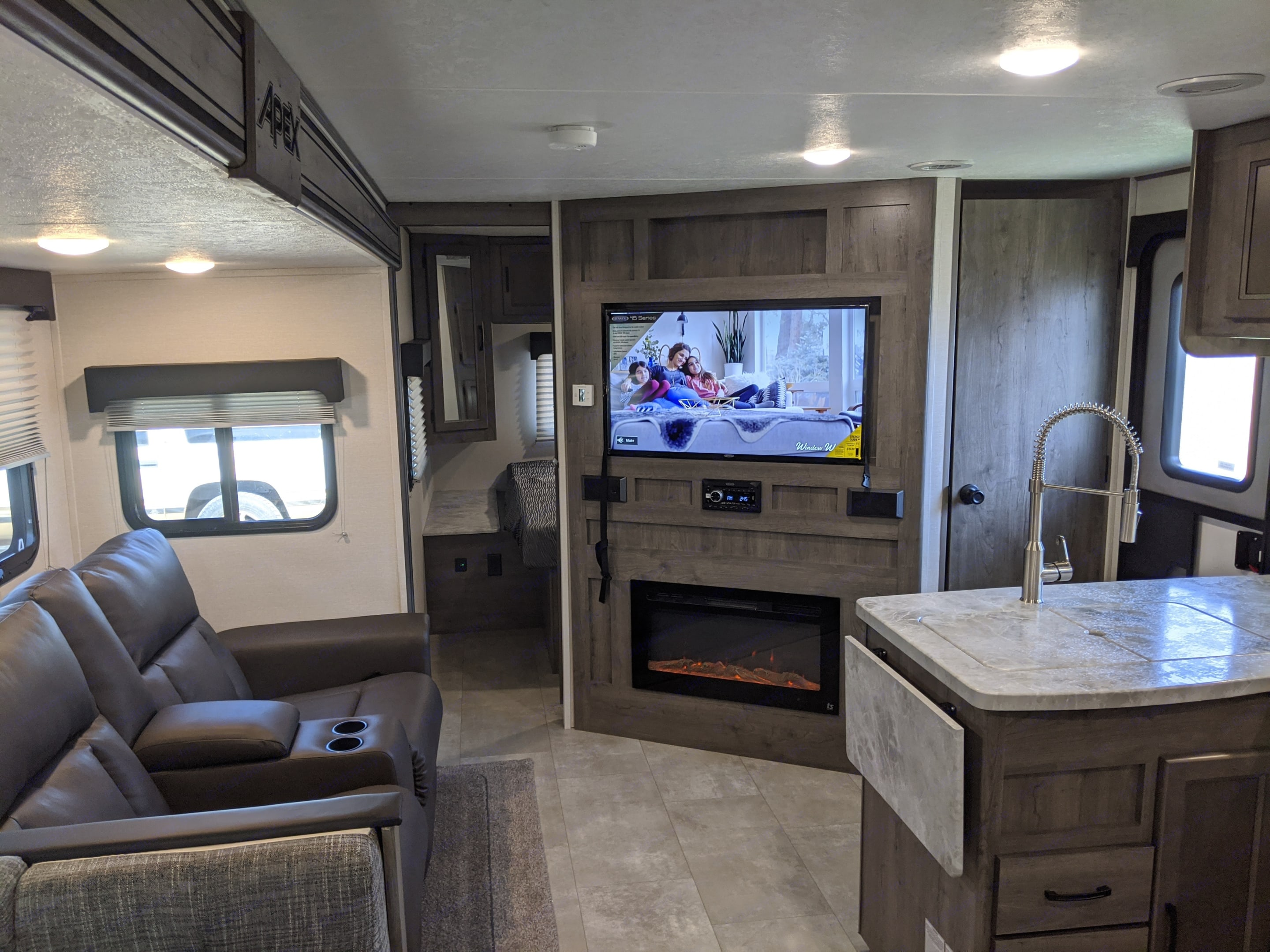 Relax by the TV and fireplace in a comfy recliner. Coachmen Apex 2021