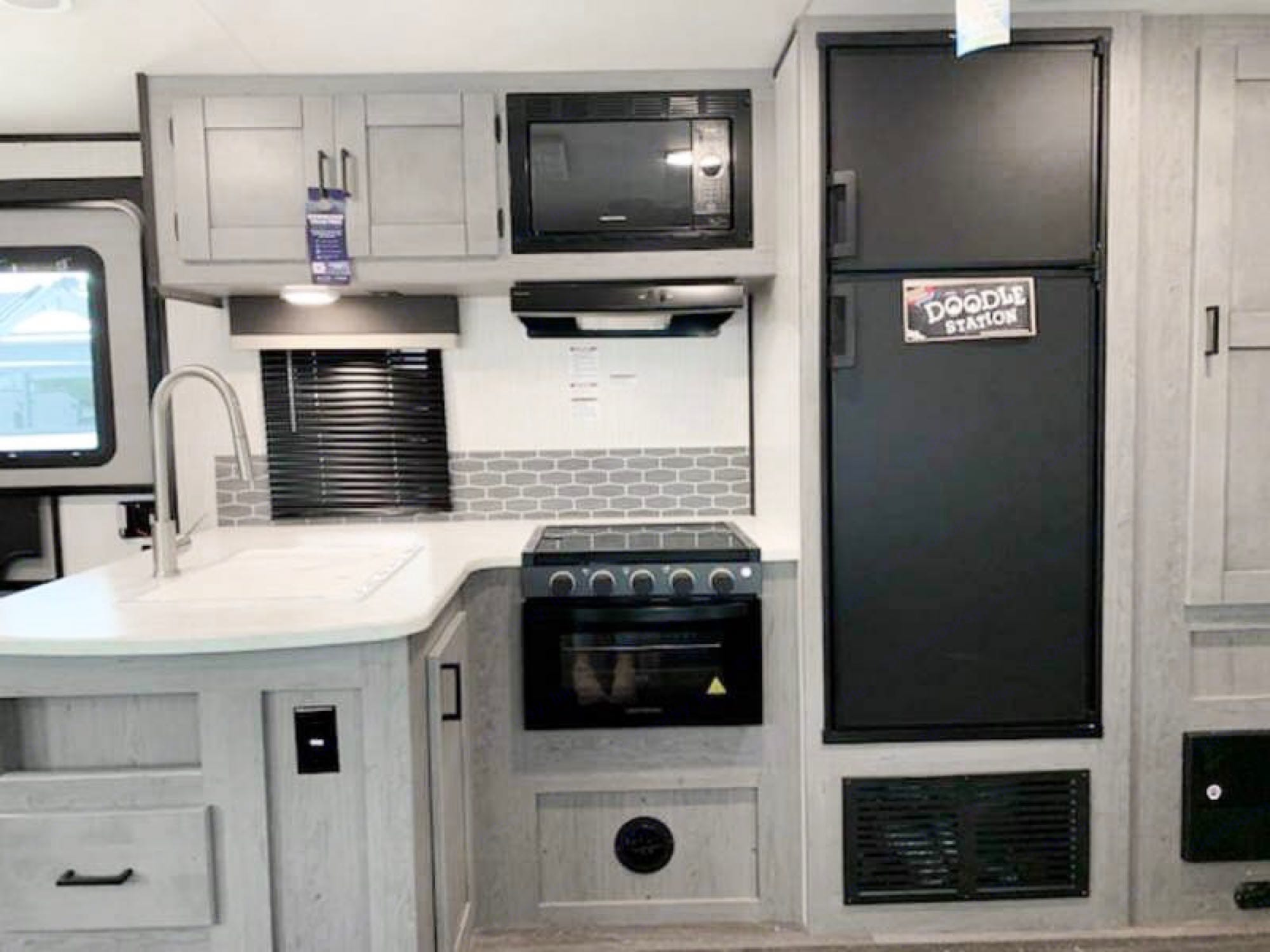 Feel right at home with a refrigerator/freezer, microwave and stove/oven! Sink has a pullout faucet. Heartland Other 2021
