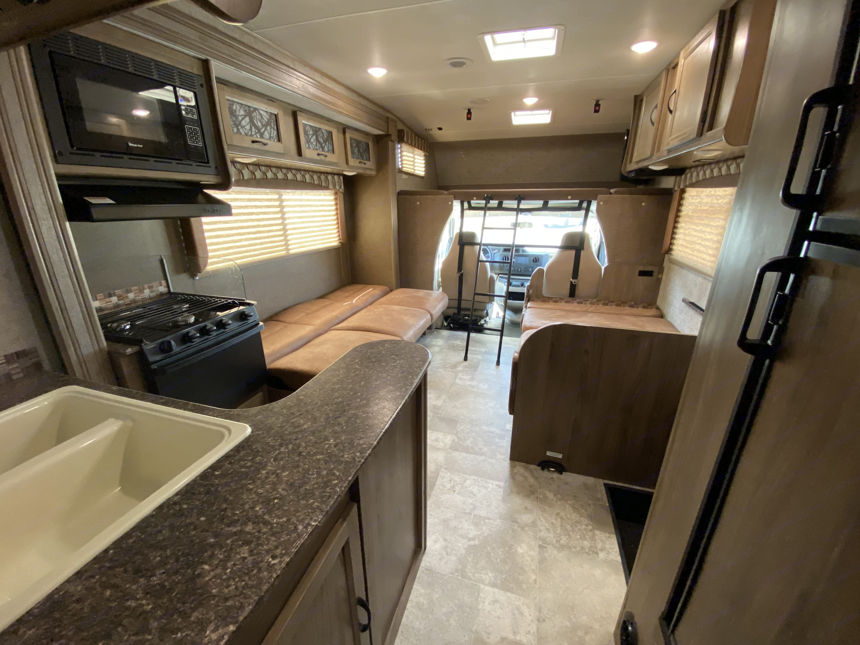 Overview of main cabin with beds folded down for sleep. Coachmen Freelander 2018
