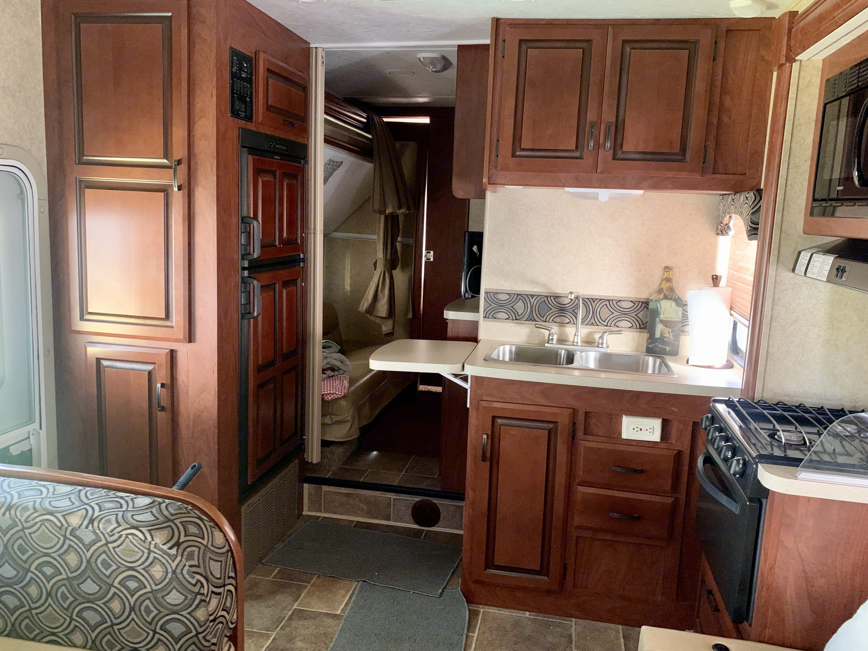 Kitchen area. Stove/Microwave/Toaster. Forest River Sunseeker 2012