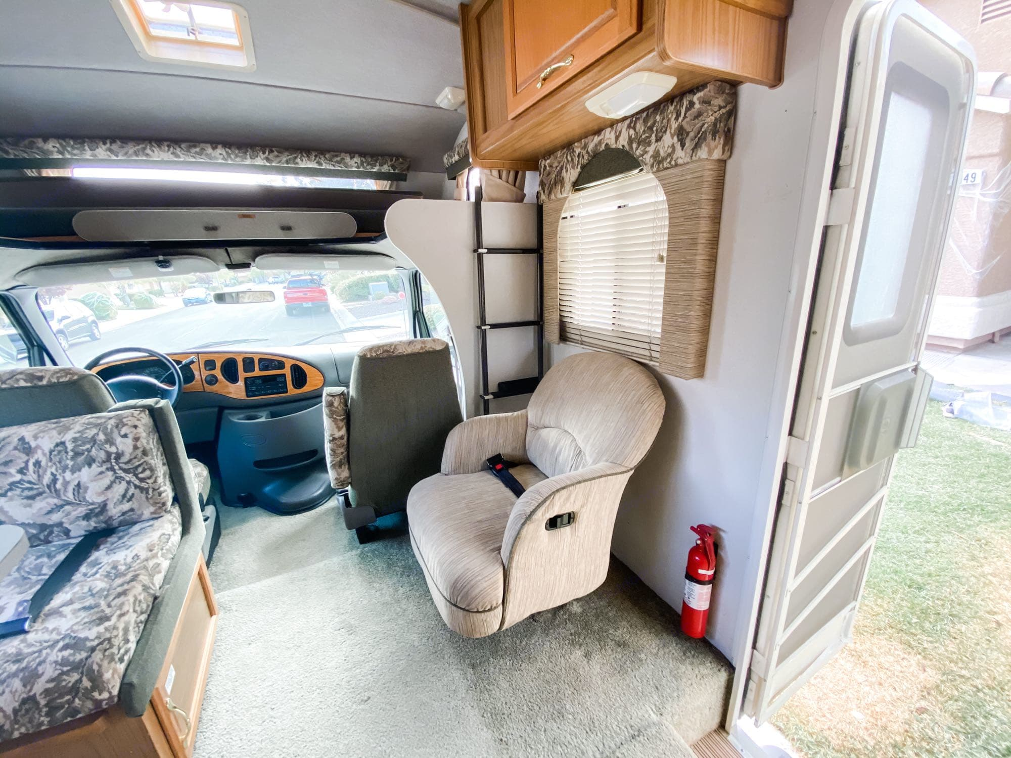 You will love having this chair opposite the dinette for extra seating. It even includes a seat belt for traveling. This motorhome has 6 seatbelts total.. Fleetwood LXE 1999