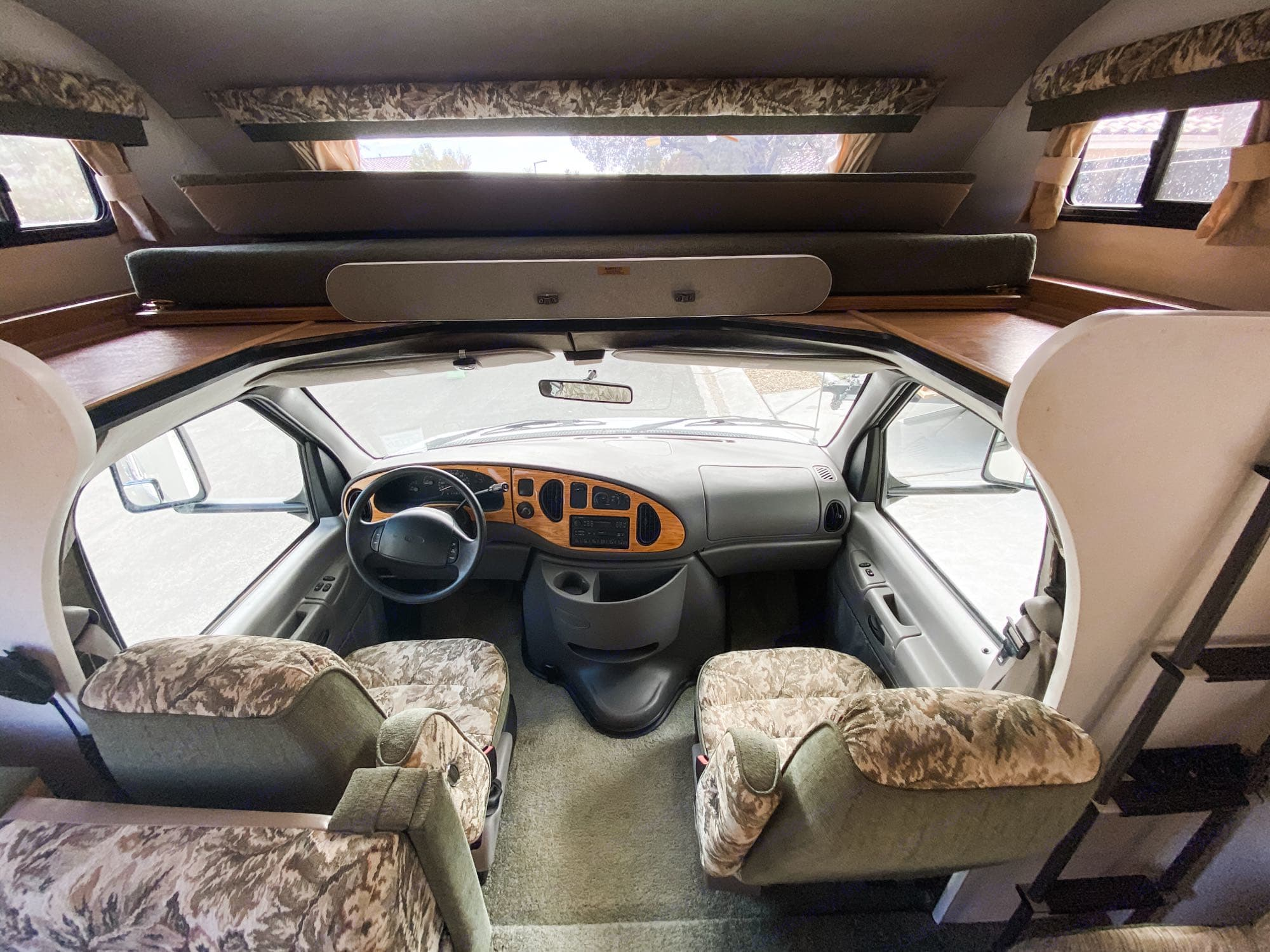 The queen size bed above the cab slides forward for easy access to the cab.. Fleetwood LXE 1999