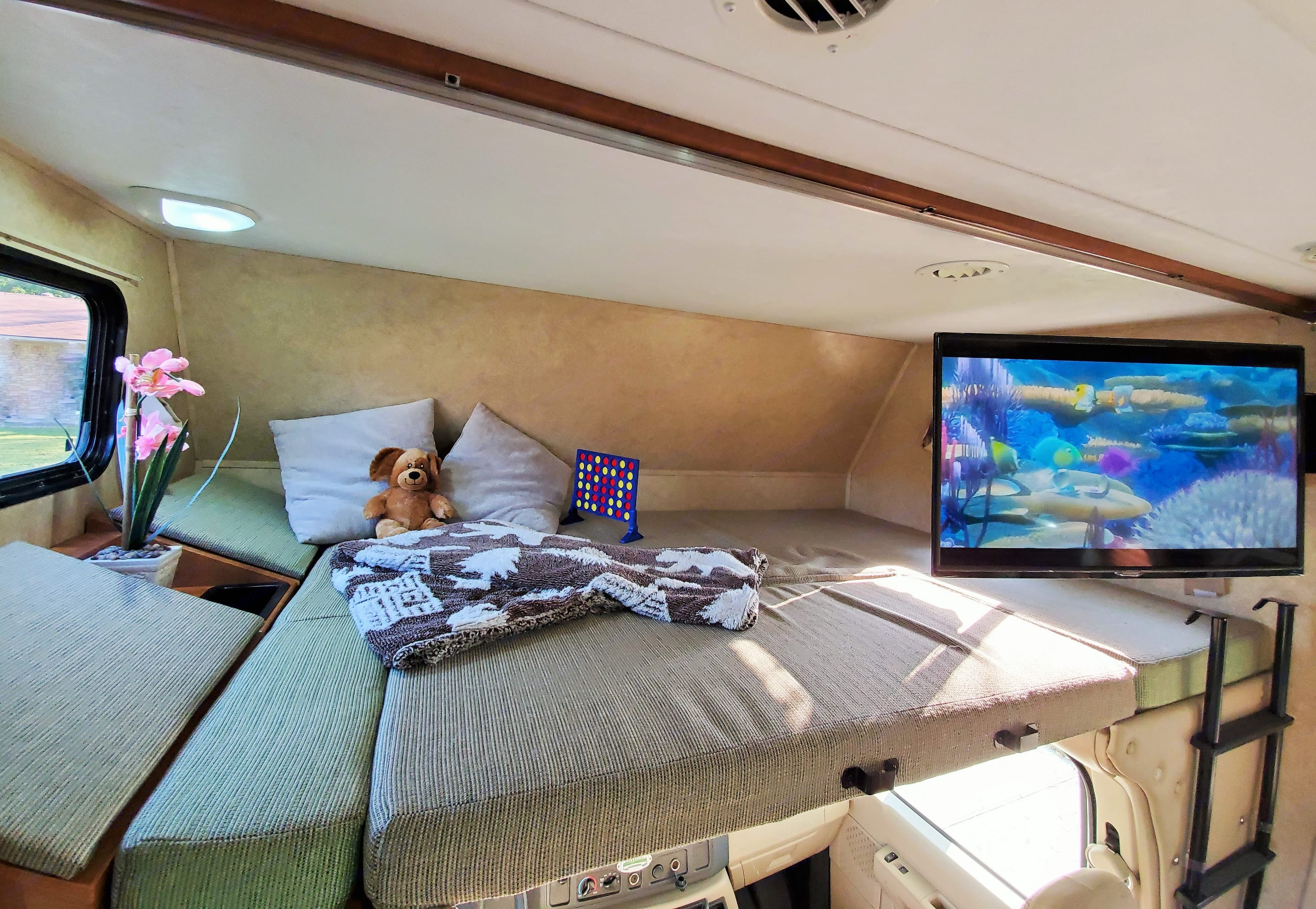 Upper bunk fits two adults confortably. Forest River Sunseeker 2011