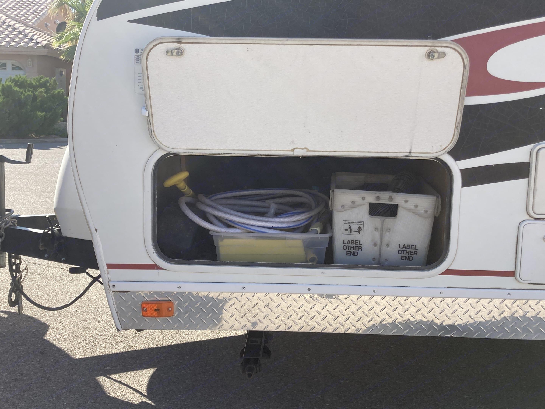 Storage with needed fresh water, tank drain hoses, etc.. Fleetwood Nitrous 2007