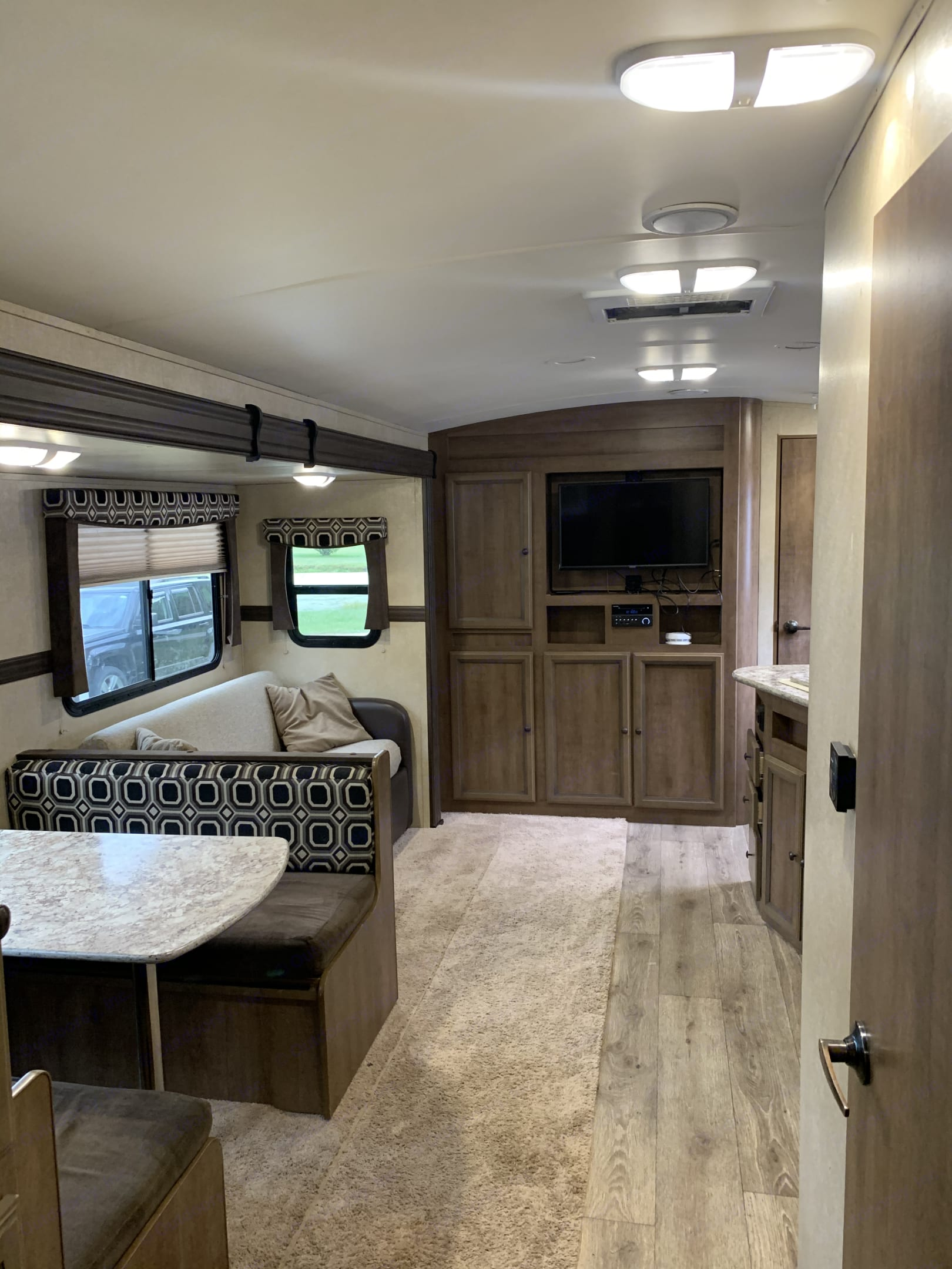 Shot from bathroom door showing living space. Cruiser Rv Corp Radiance 2015