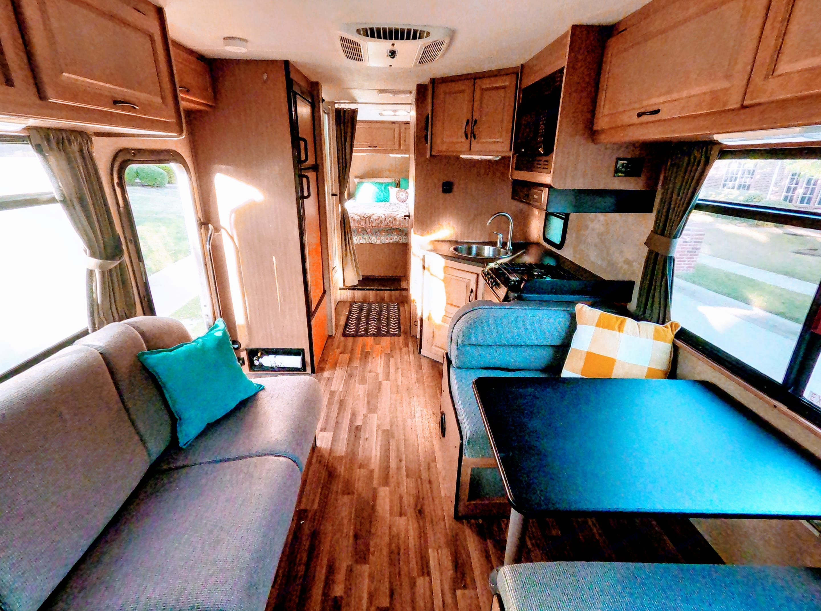 Living Area.  Features a dinette with seatbelts for 4 and couch with seatbelts for 3.. Thor Motor Coach Four Winds Majestic 2016