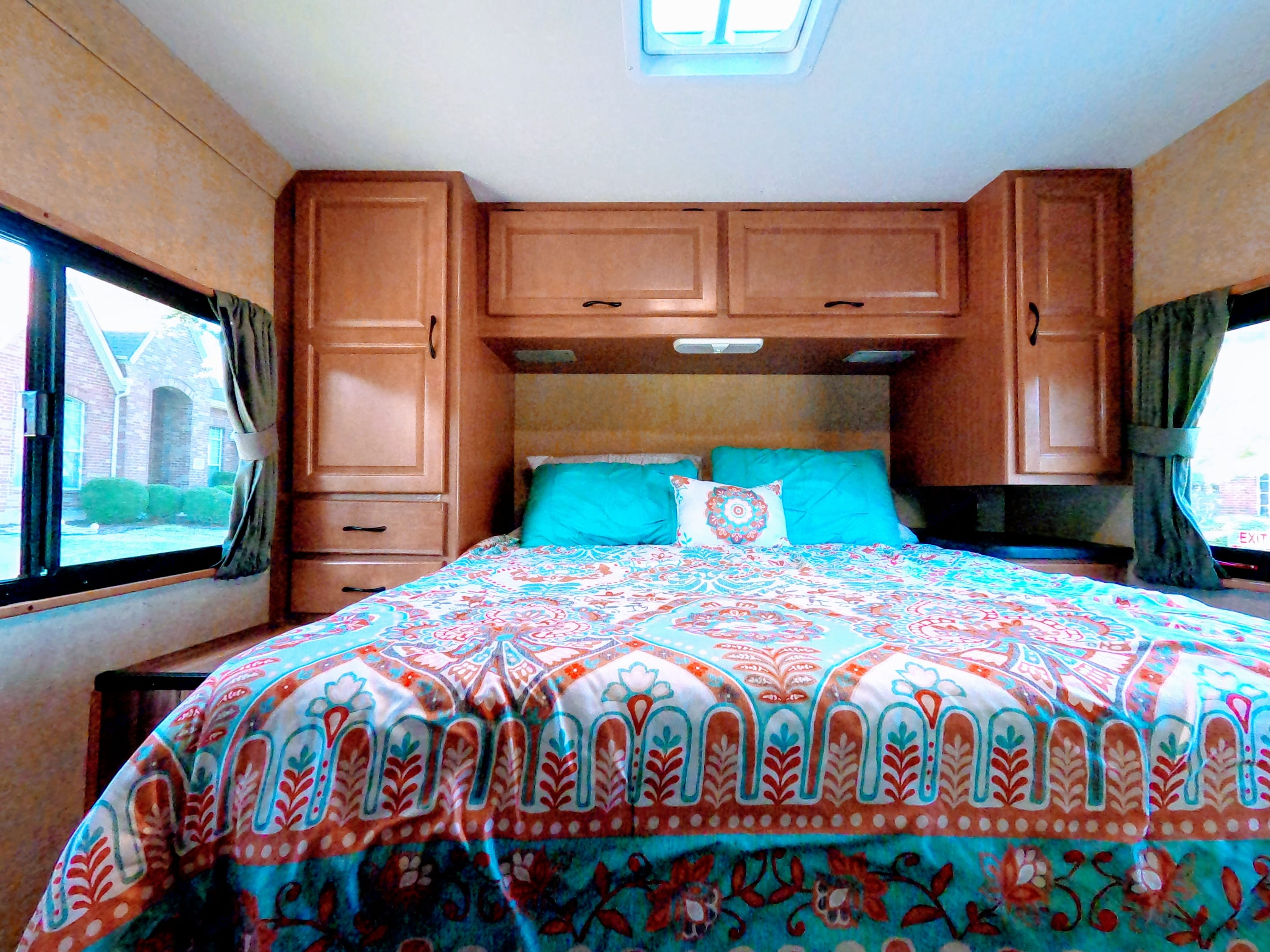 Back Bedroom. Features a queen size bed and plenty of storage.. Thor Motor Coach Four Winds Majestic 2016