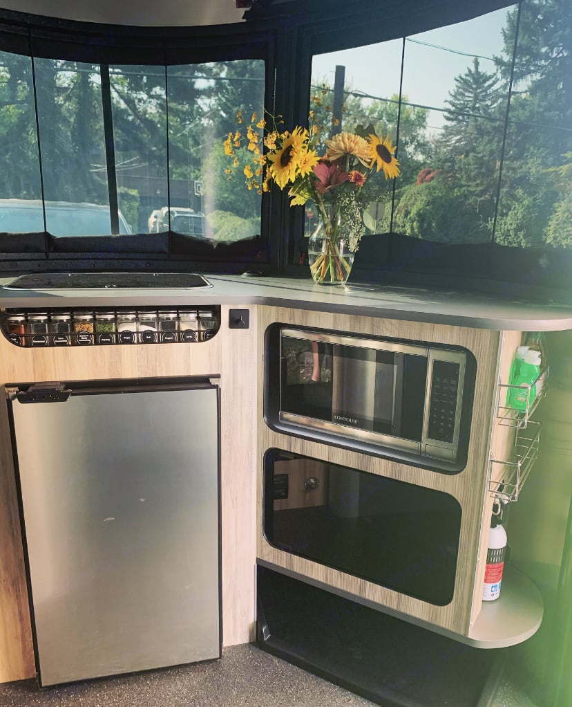 Microwave needs shore-power to operate. Fridge can operate on solar.  . Airstream Base Camp X 2020