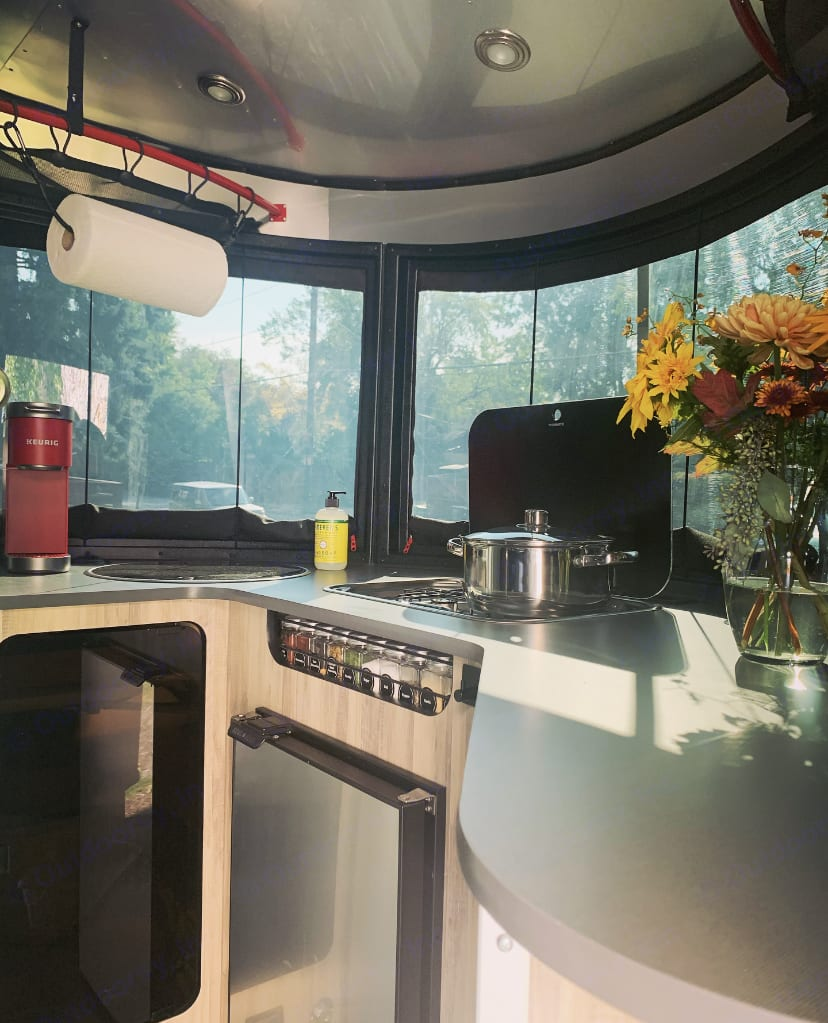 Fully equipped Kitchenette that offers everything from Refrigerator, Two-burner Stove, Microwave to Stainless Steel Pot&Pan, and Assorted Seasonings. . Airstream Base Camp X 2020