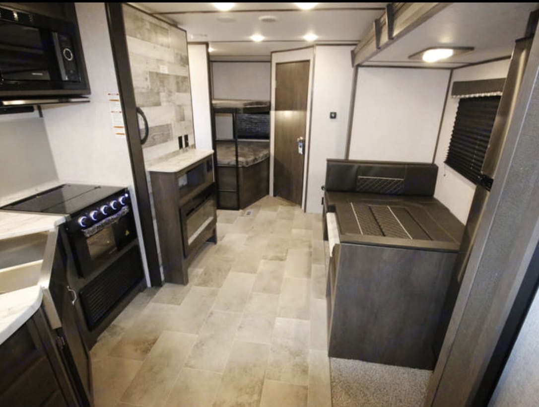 In the trailer big dinning place & the oven. You can cook & nobody will bother you while passing . Coleman Other 2021