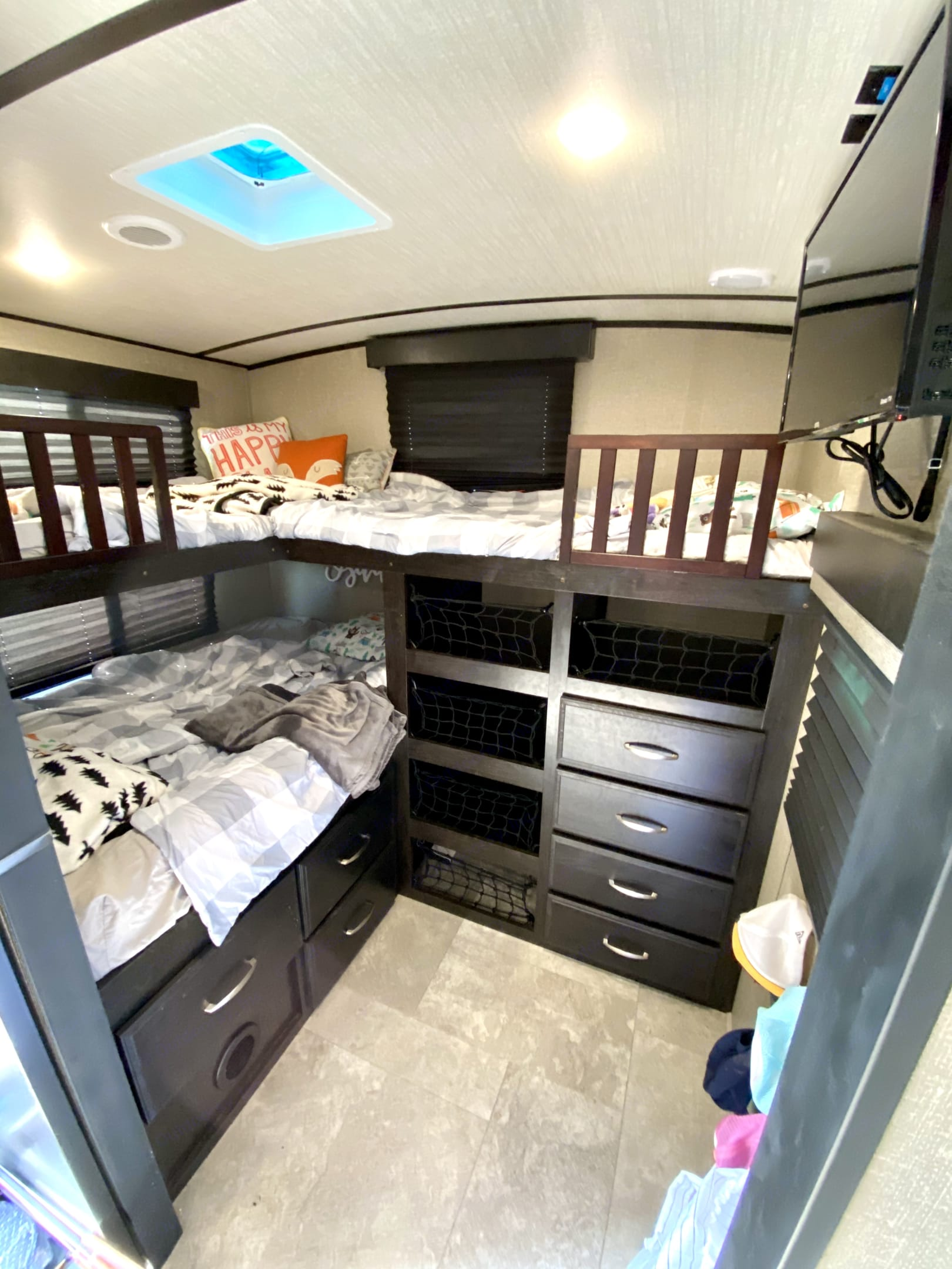 Bunk room. Two single bunks and one double bunk. Plentiful storage and mounted tv.. Grand Design Other 2019