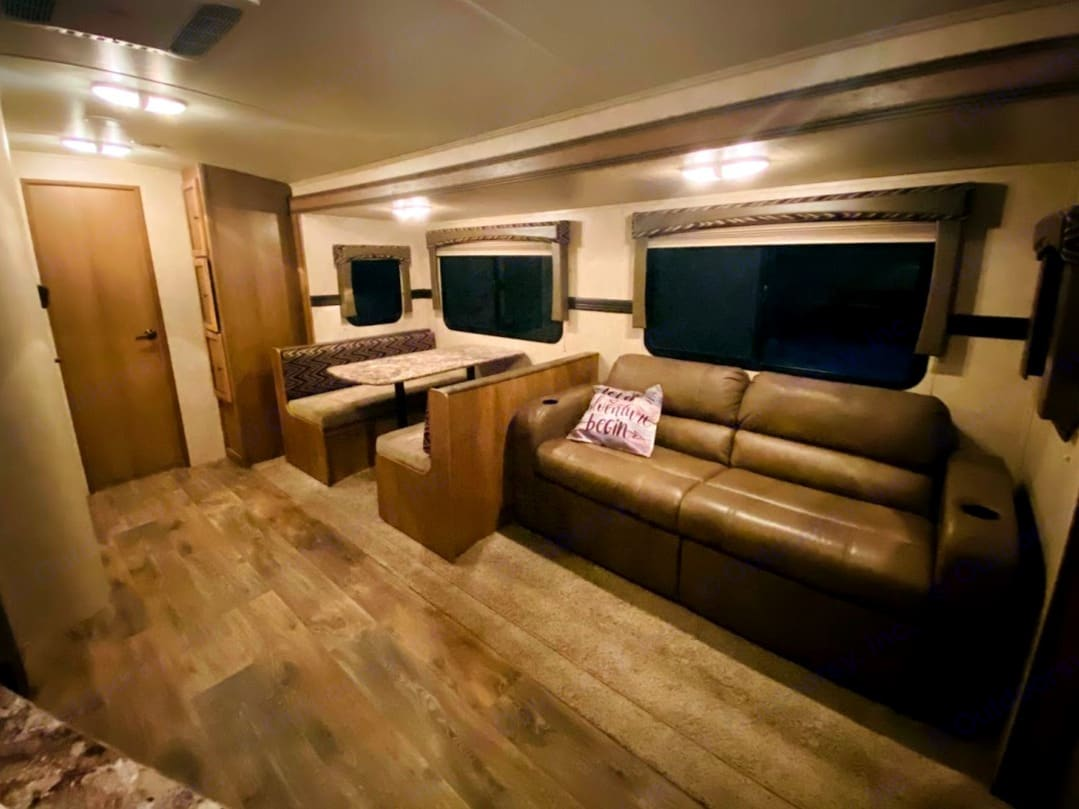 Living room with dinette/twin bed, sofa bed and rear bedroom.. Cruiser Rv Corp Shadow Cruiser 2016