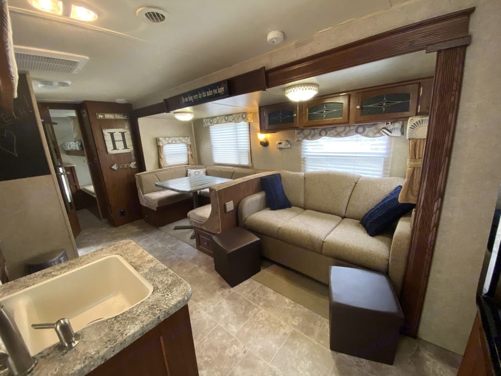 Living area with super comfy full size air mattress sleeper sofa. Forest River Rockwood Signature Ultra 2012