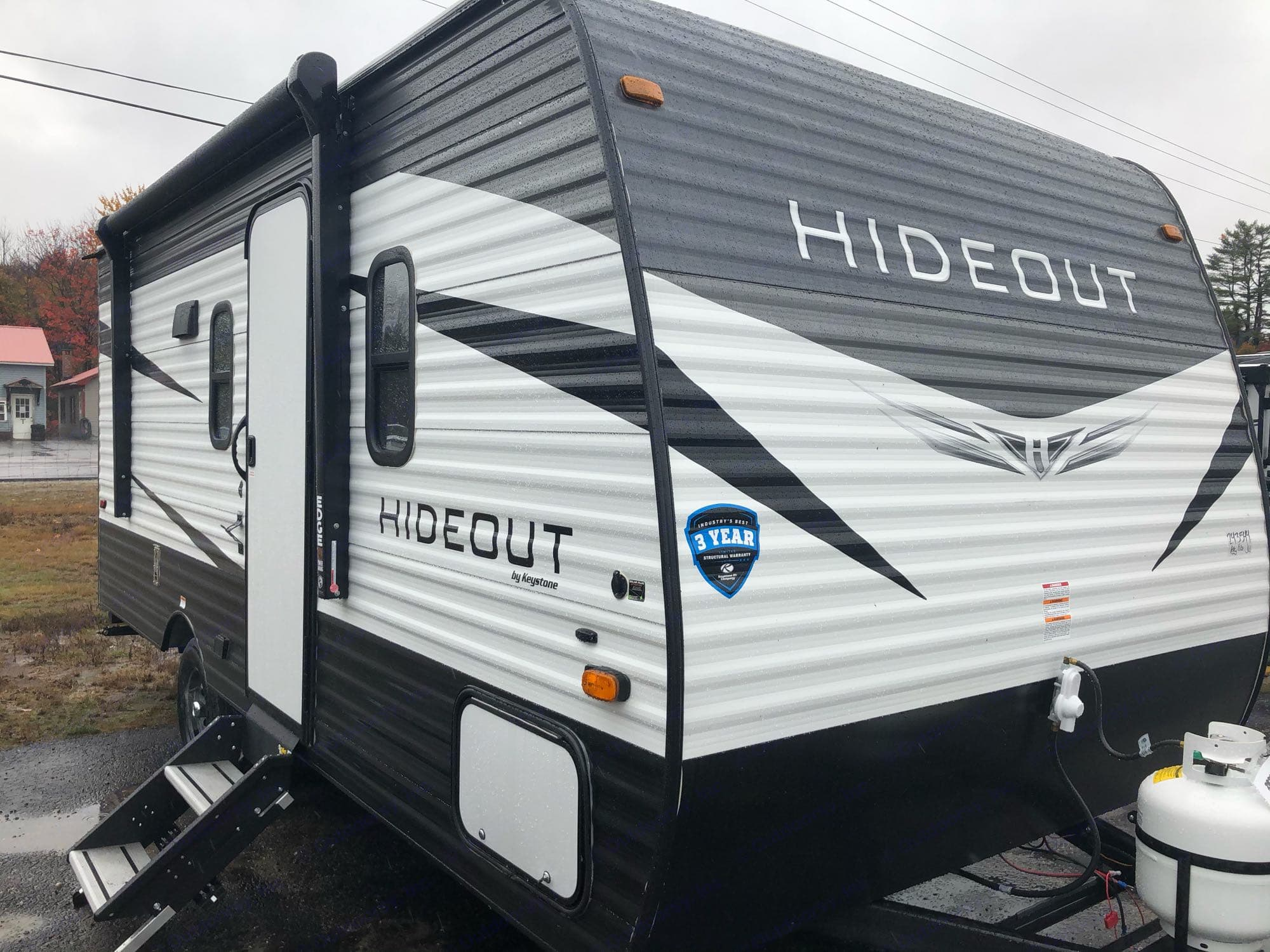 Hideout Exterior with electric awning.. Keystone Hideout 179LHS 2021