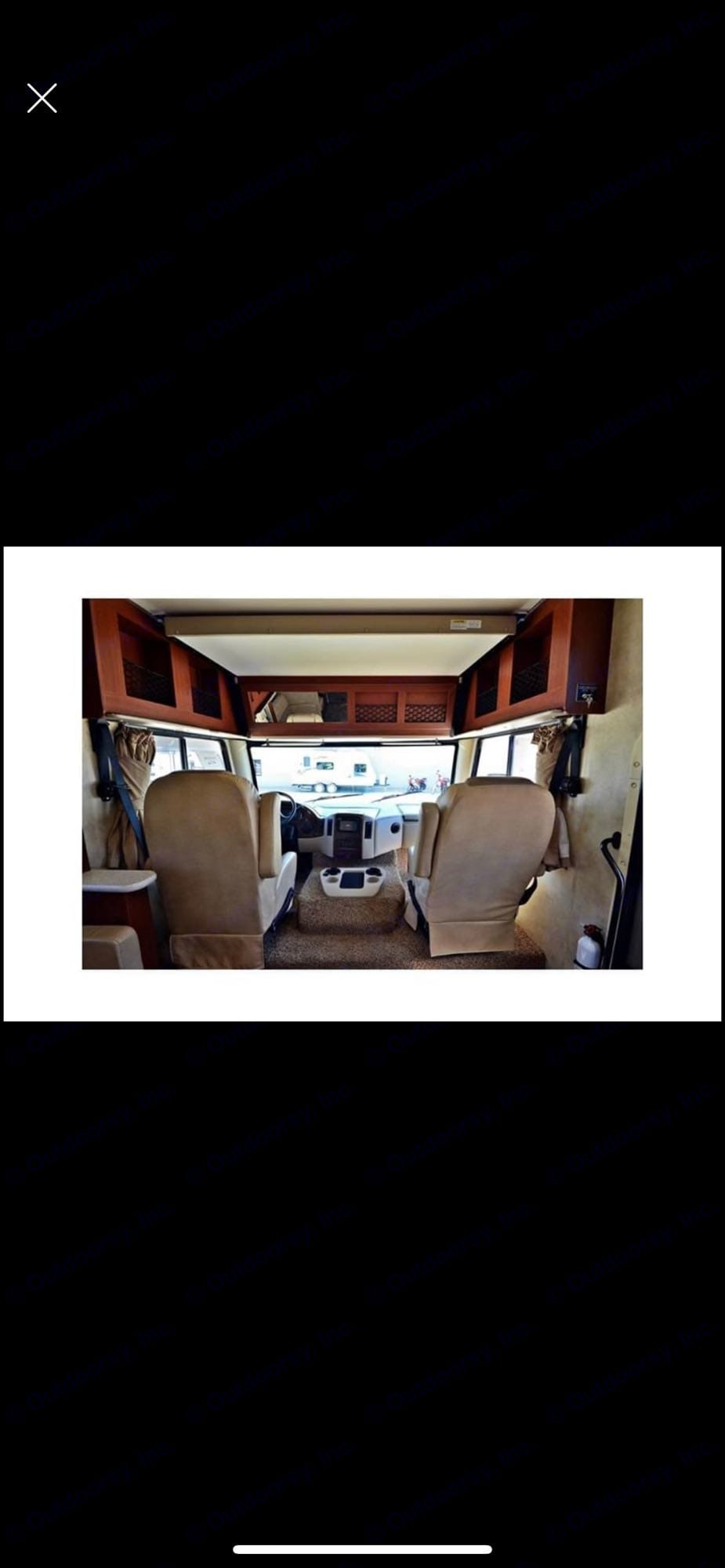 Driver and Passenger seats with overhead bed. Thor Motor Coach A.C.E 2013