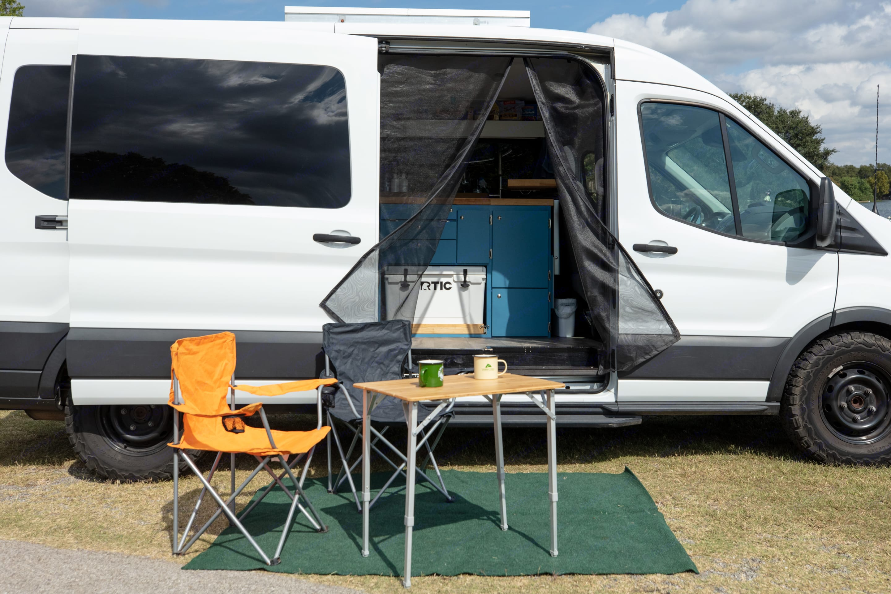 Outdoor seating area with bug net on slider door. Ford Custom Transit 2016