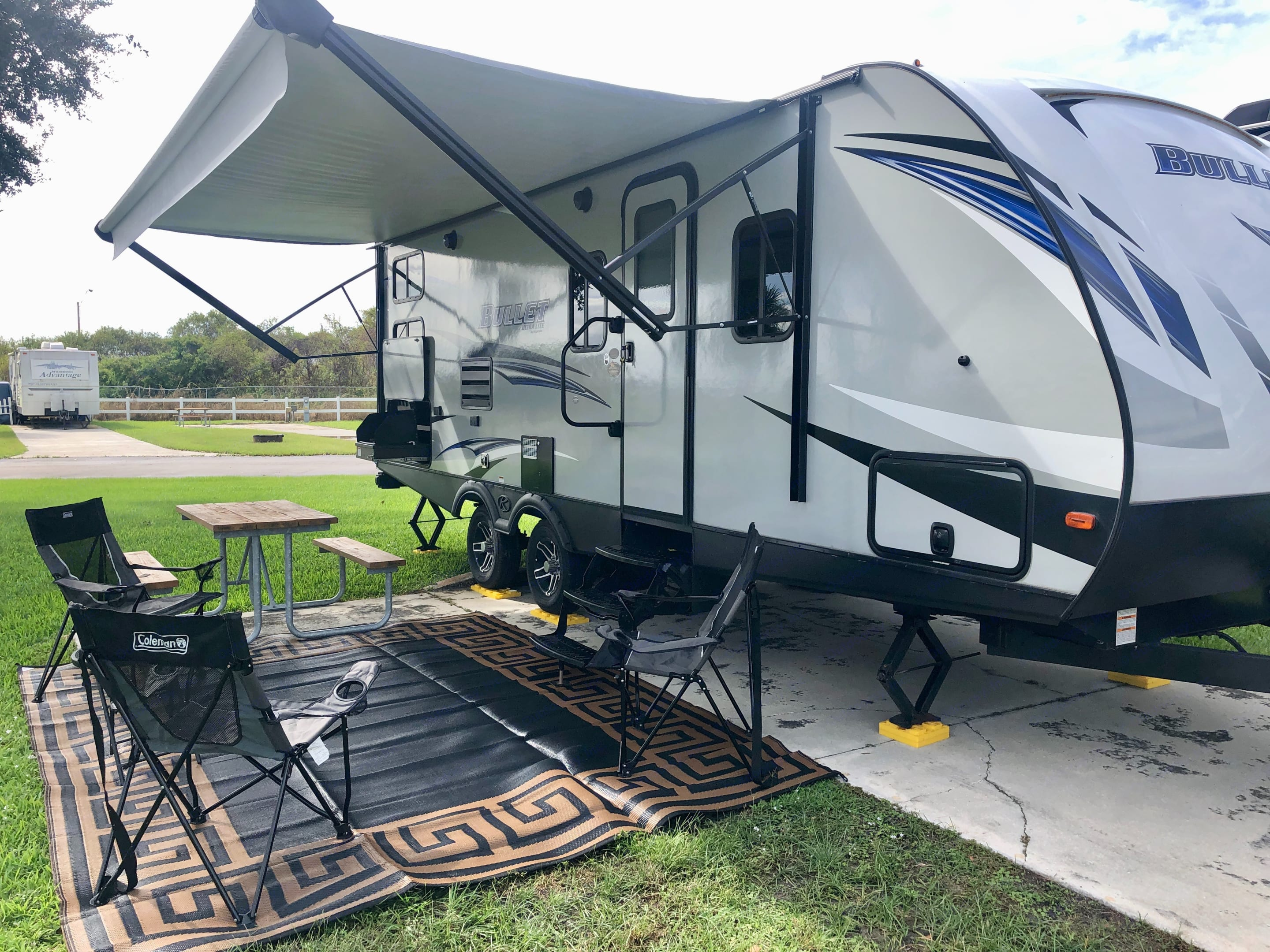 The RV with the Outdoor add on set up. Keystone Bullet 2020
