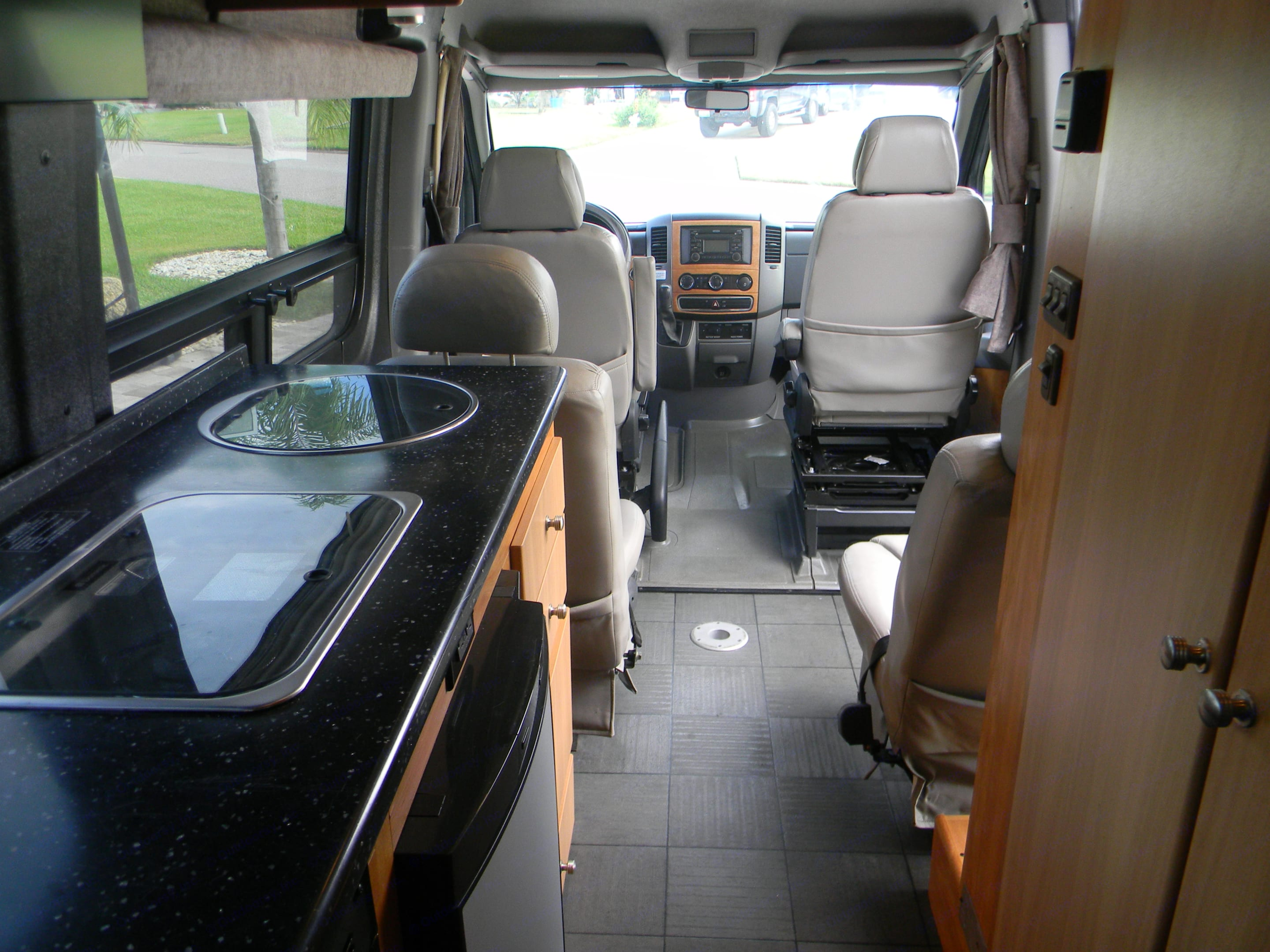 view from rear, galley on left and bathroom on right. Winnebago Era 2010