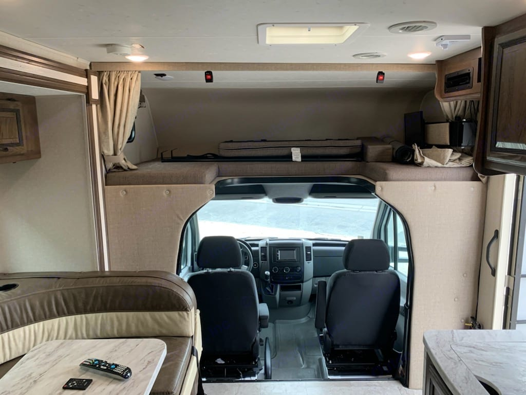 bed with safety net and curtain for privacy that covers the cockpit, so no one can see in.. coachman Prism 2018