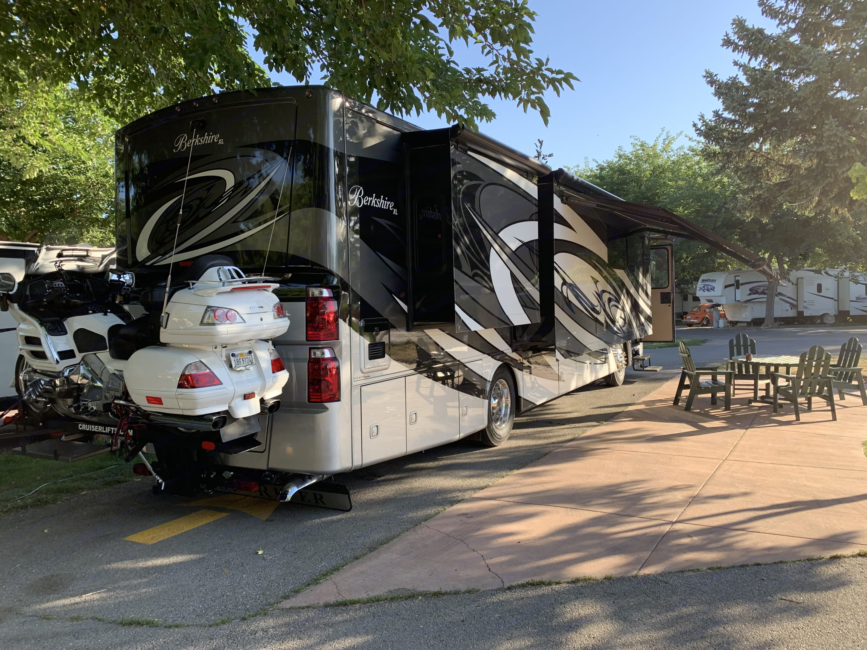 Beautiful Luxury Coach, rear view of CruiserLyft with our Honda Goldwing. Luxury Forest River Berkshire 2020