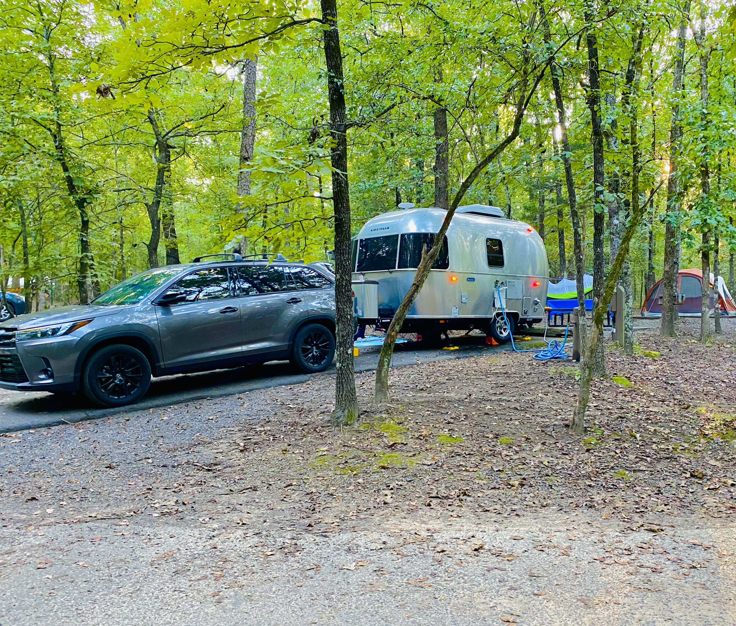 RV camp with tent. Airstream Sport 2020