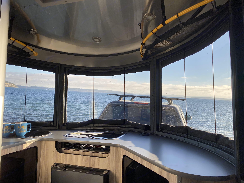 Beautiful panoramic front windows!. Airstream Base Camp 2021