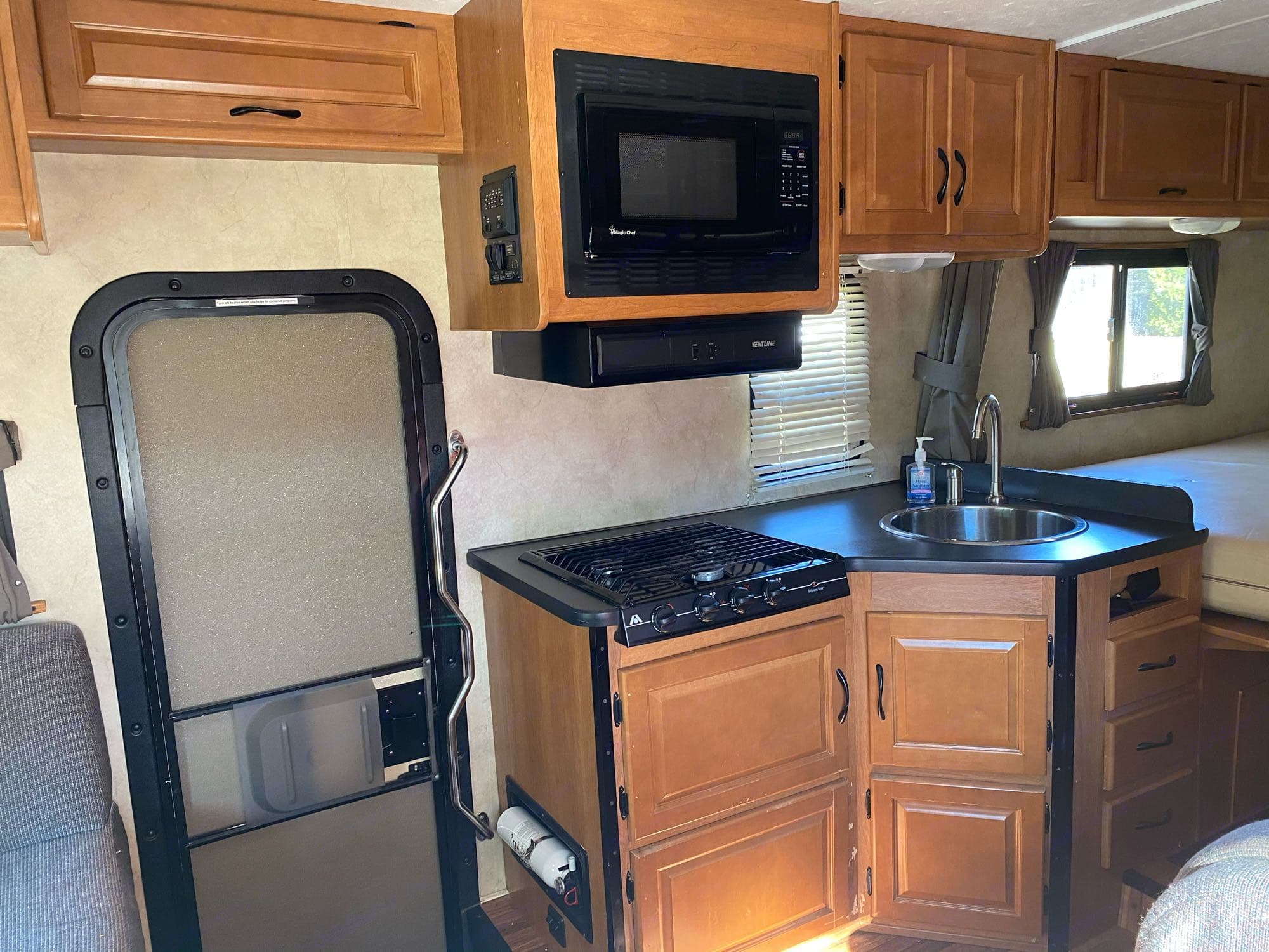 Kitchen has sink, microwave and stove. Basic cookware and dishes included.. Thor Motor Coach Four Winds Majestic 2013