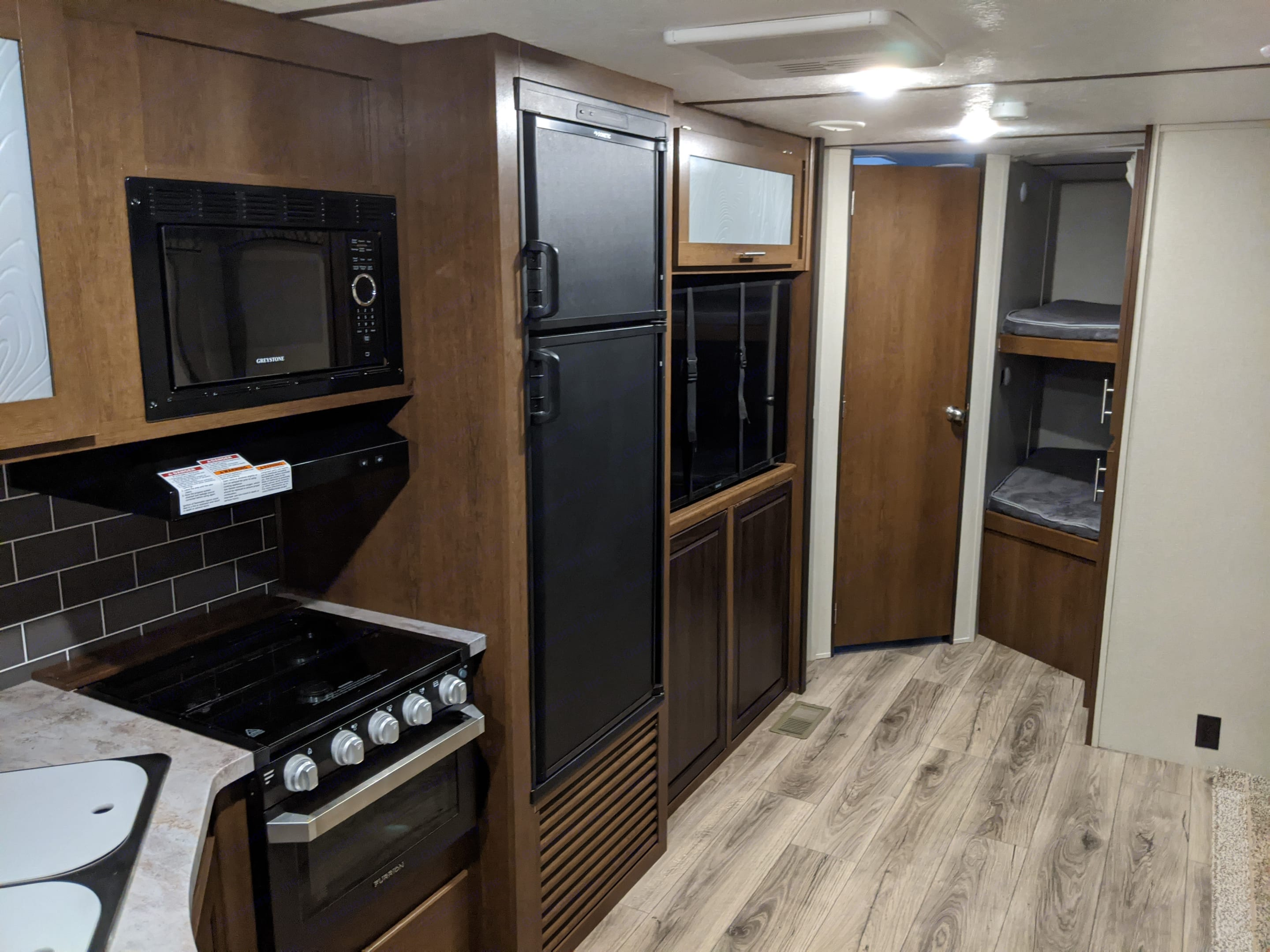 Refrigerator and Freezer as well as Big Screen Tv on a swivel for everyone to view.. Forest River Wildcat 2020